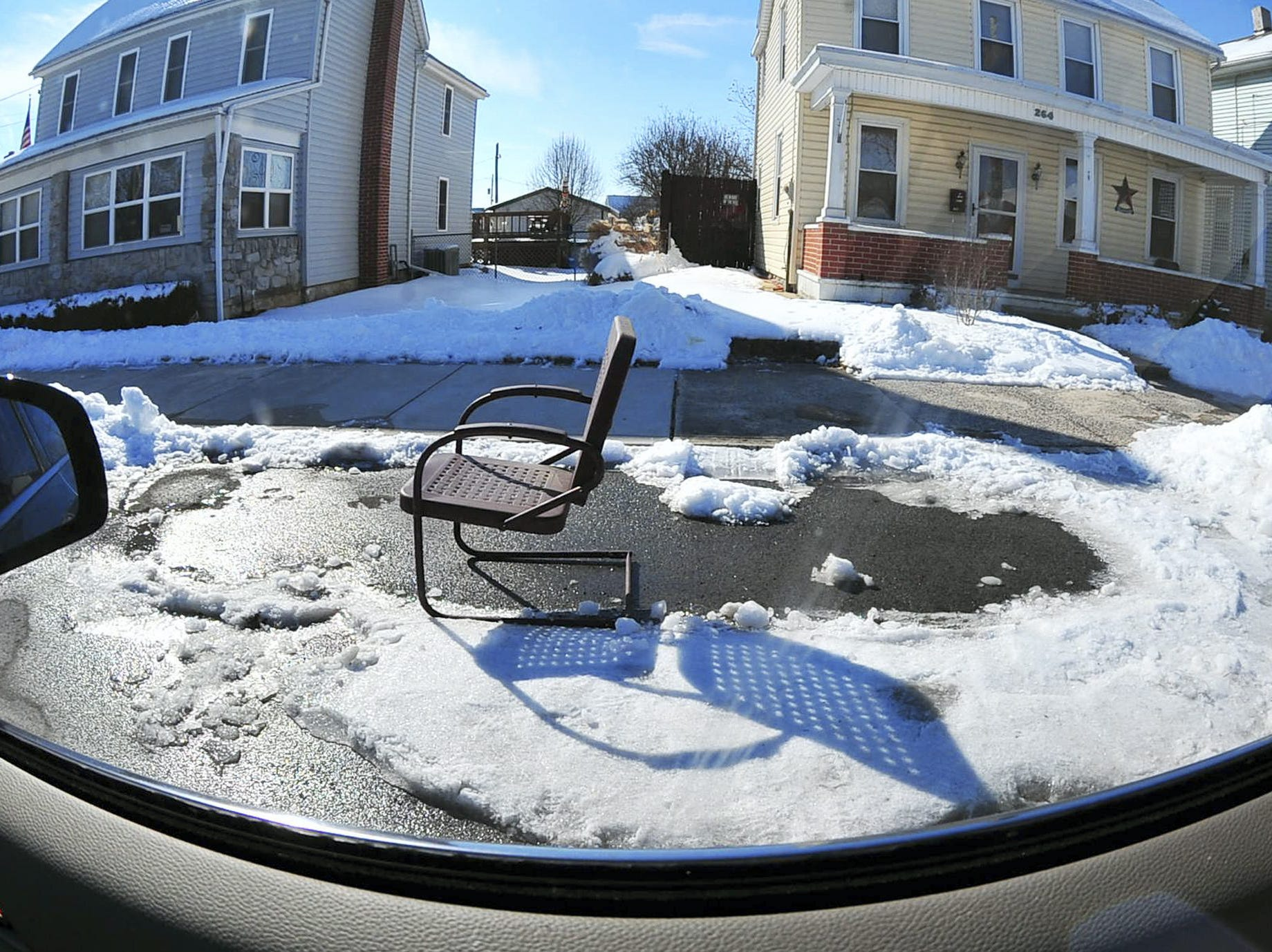 Chairs are a popular way to save a parking space - this one in Chambersburg.