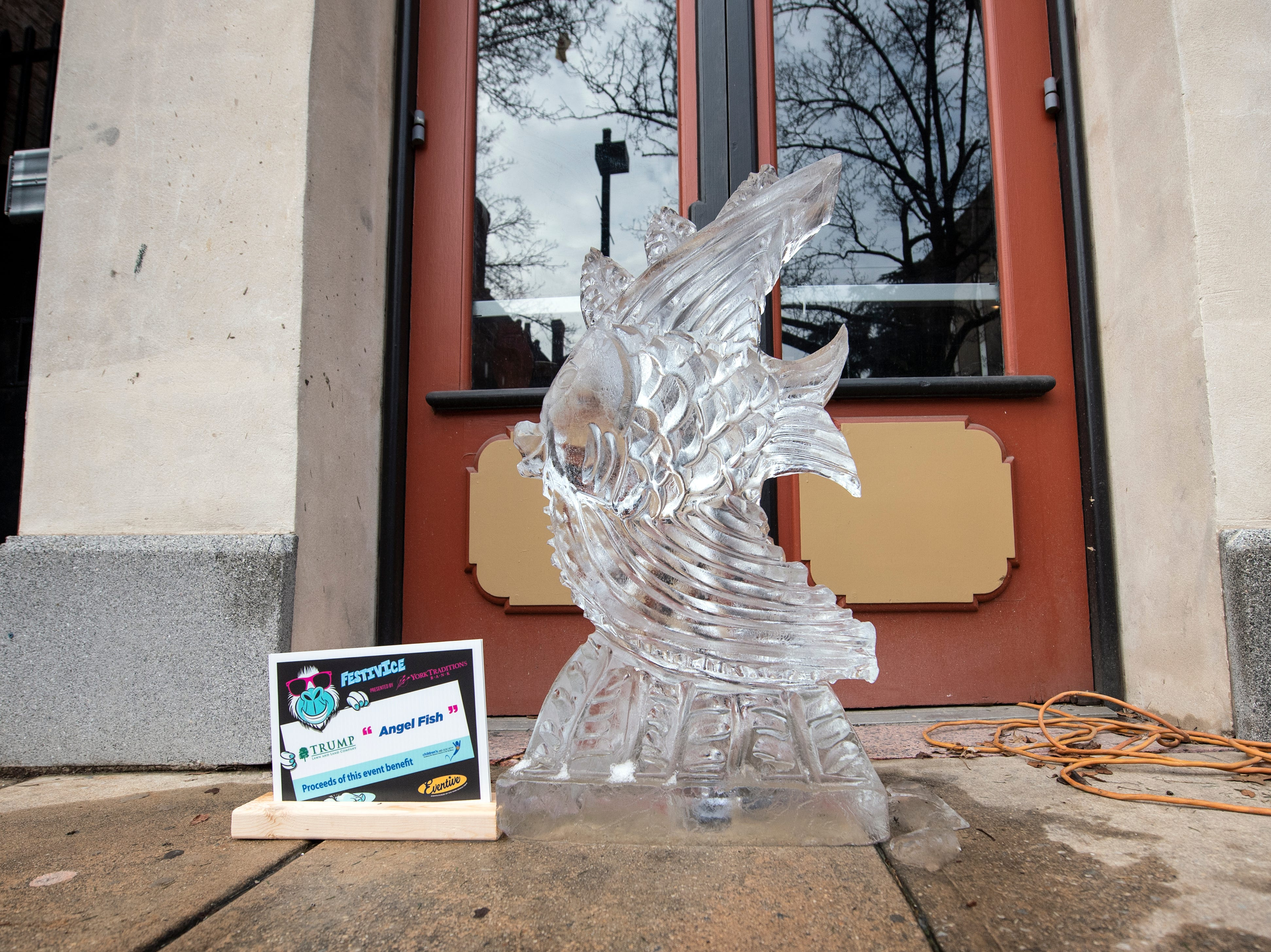 'Angel Fish' is one of many ice sculptures downtown, Friday, Jan. 18, 2019. The FestivICE ice festival has interactive ice sculptures, an ice slide and more. The three-day event ends Saturday.