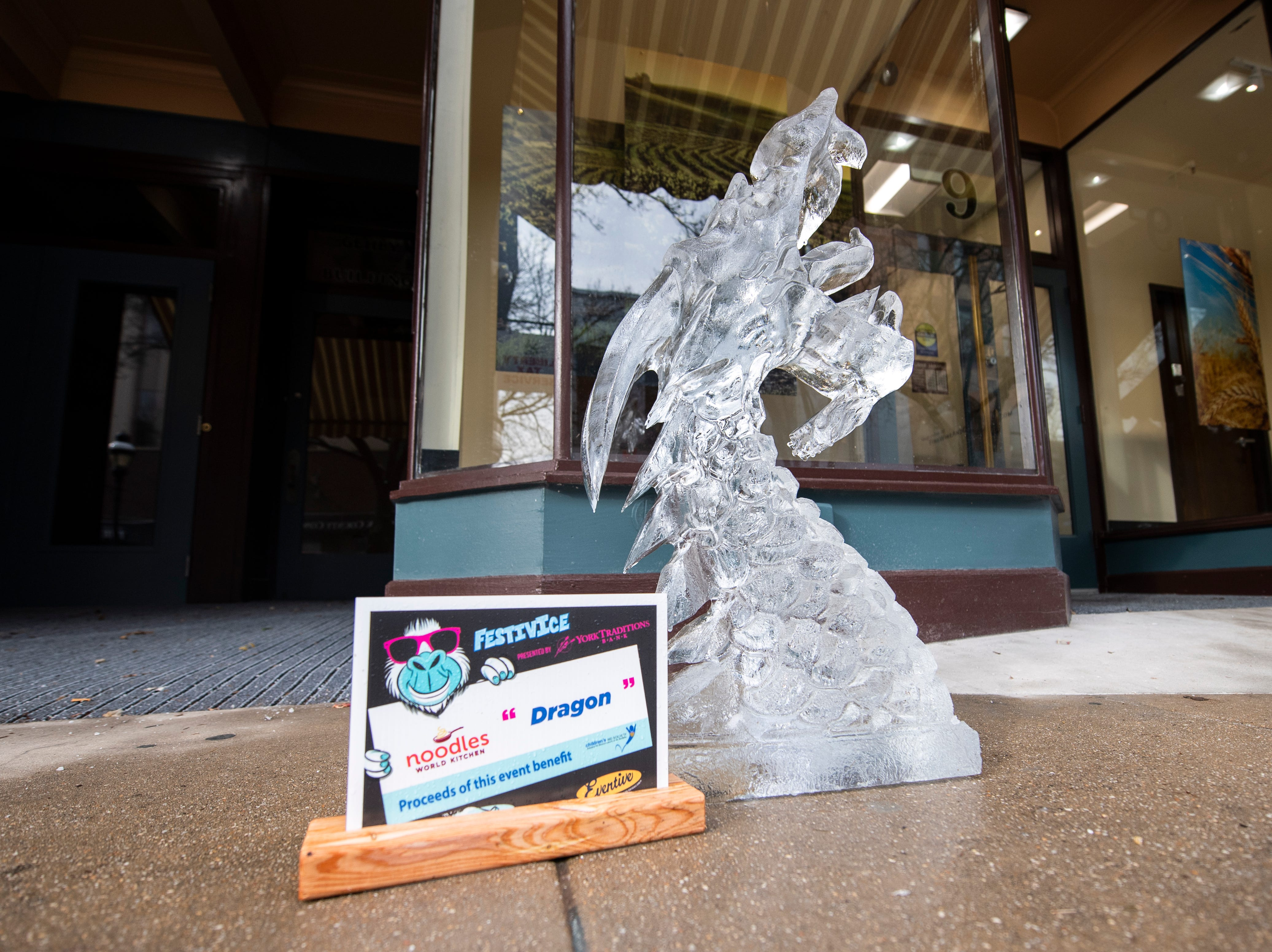 'Dragon' is one of many ice sculptures downtown, Friday, Jan. 18, 2019. The FestivICE ice festival has interactive ice sculptures, an ice slide and more. The three-day event ends Saturday.
