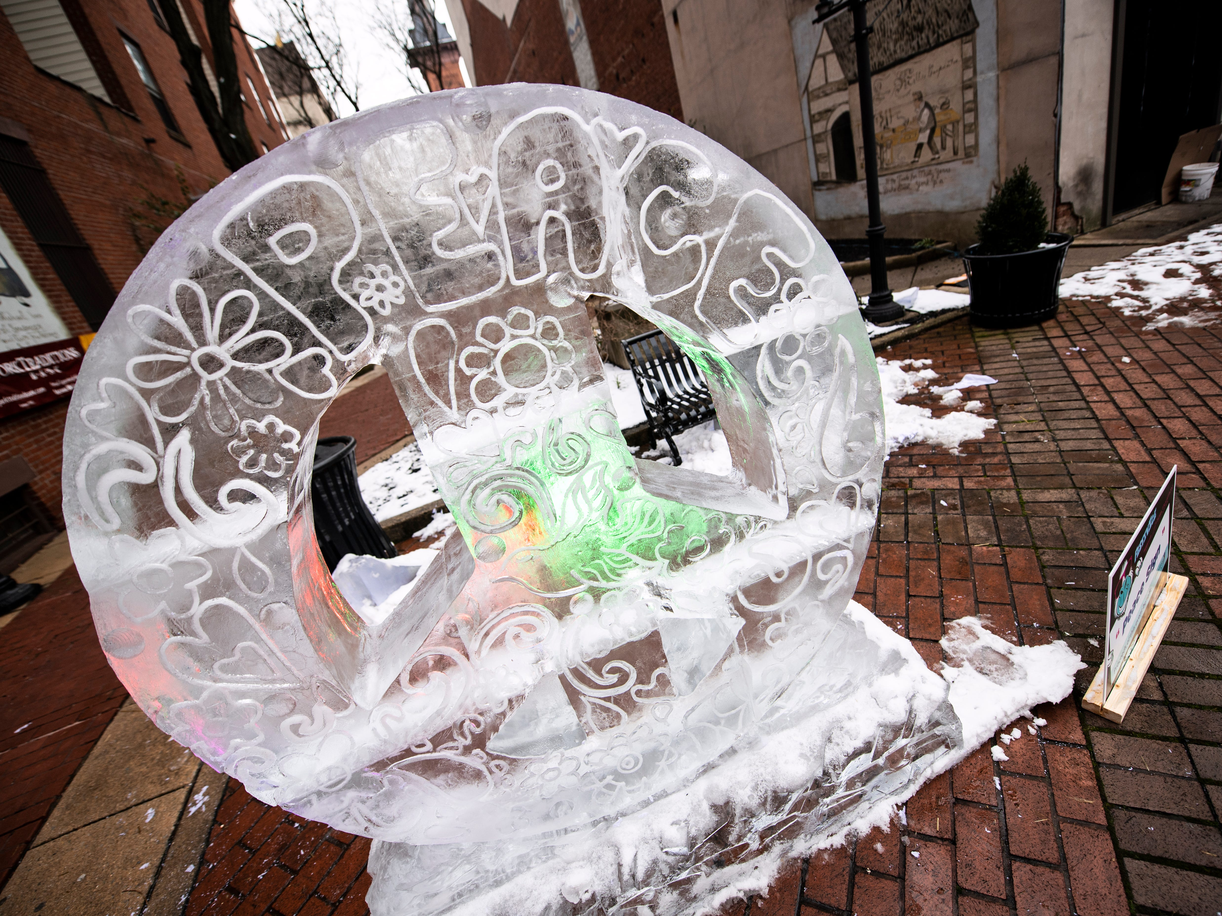The 'peace sign' sculpture, decked out with lights, is one of more than two dozen ice sculptures in and around Cherry Lane in York.