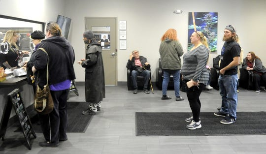 People wait in line on the opening day of Fernley's dispensary.