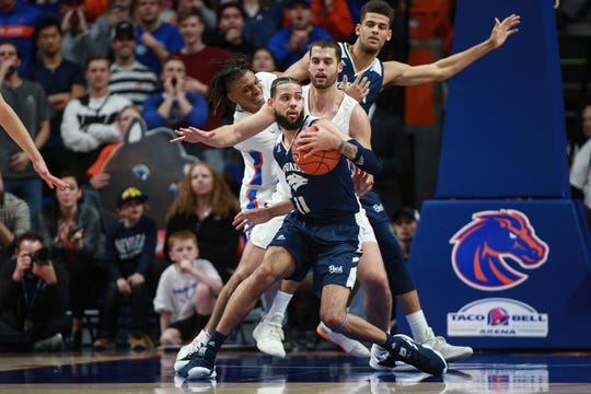 Nevada forward Cody Martin (11) works against Boise State's David Wacker (33) during the second half of Tuesday's game in Boise.