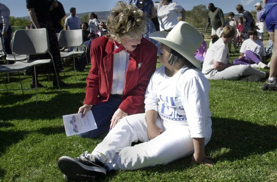 Sherri David, director of the Reno Rodeo, shares her hat with Marvin Picollo student Jennifer Marinez at the ground breaking for a new indoor facility at the school in 2002.
