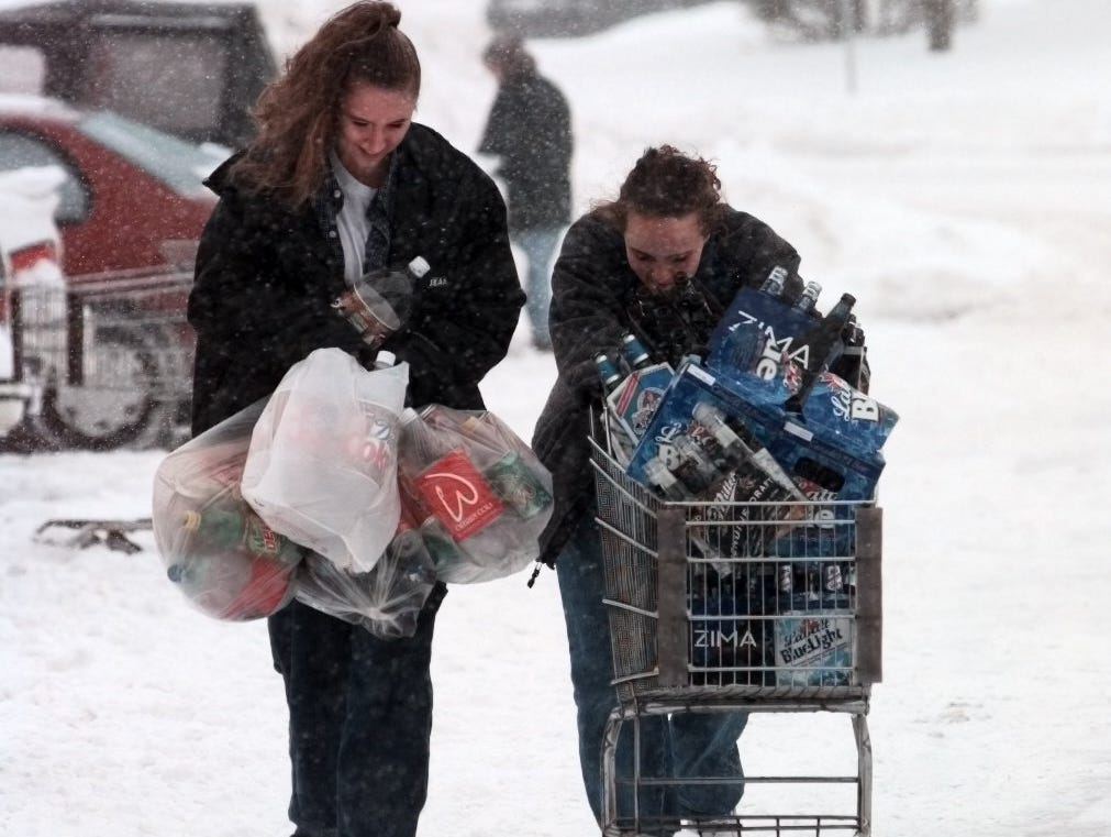 4 (tie). Snowfall totaled 18.4 inches on March 6, 1999. Here, two women struggle through a parking lot in Henrietta.