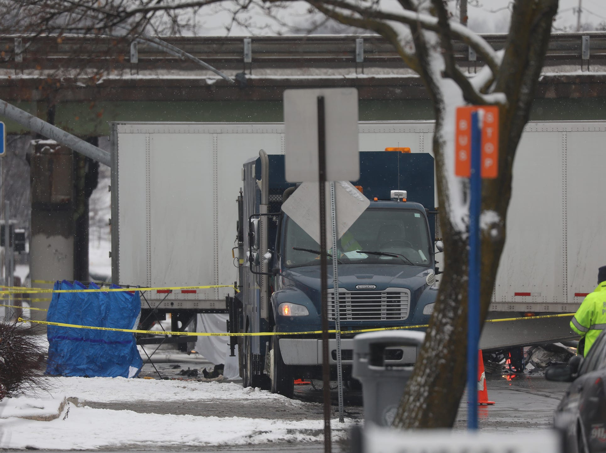 Two workers were working inside a sewer grate, one got away from the oncoming truck, the other was killed instantly.
