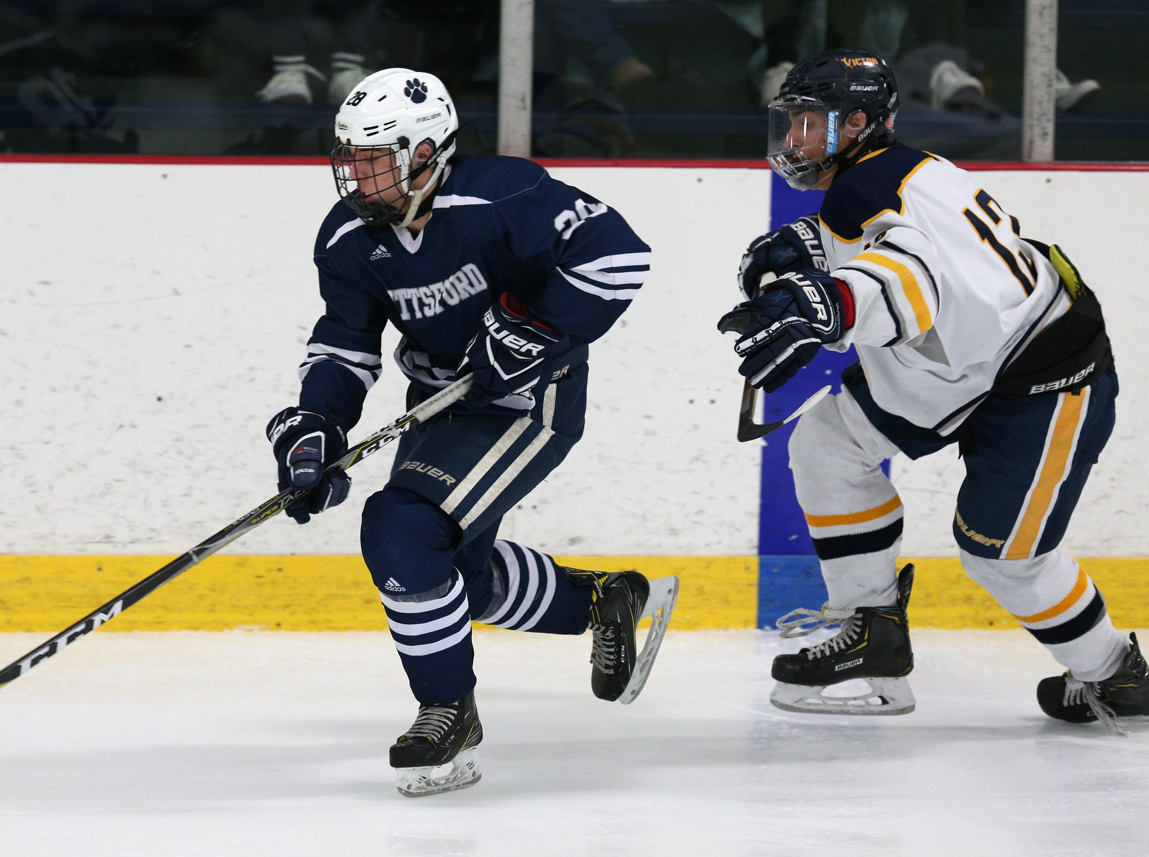 Pittsford #28 Shawn Alexander against Victor # 13 Jack McCandless.