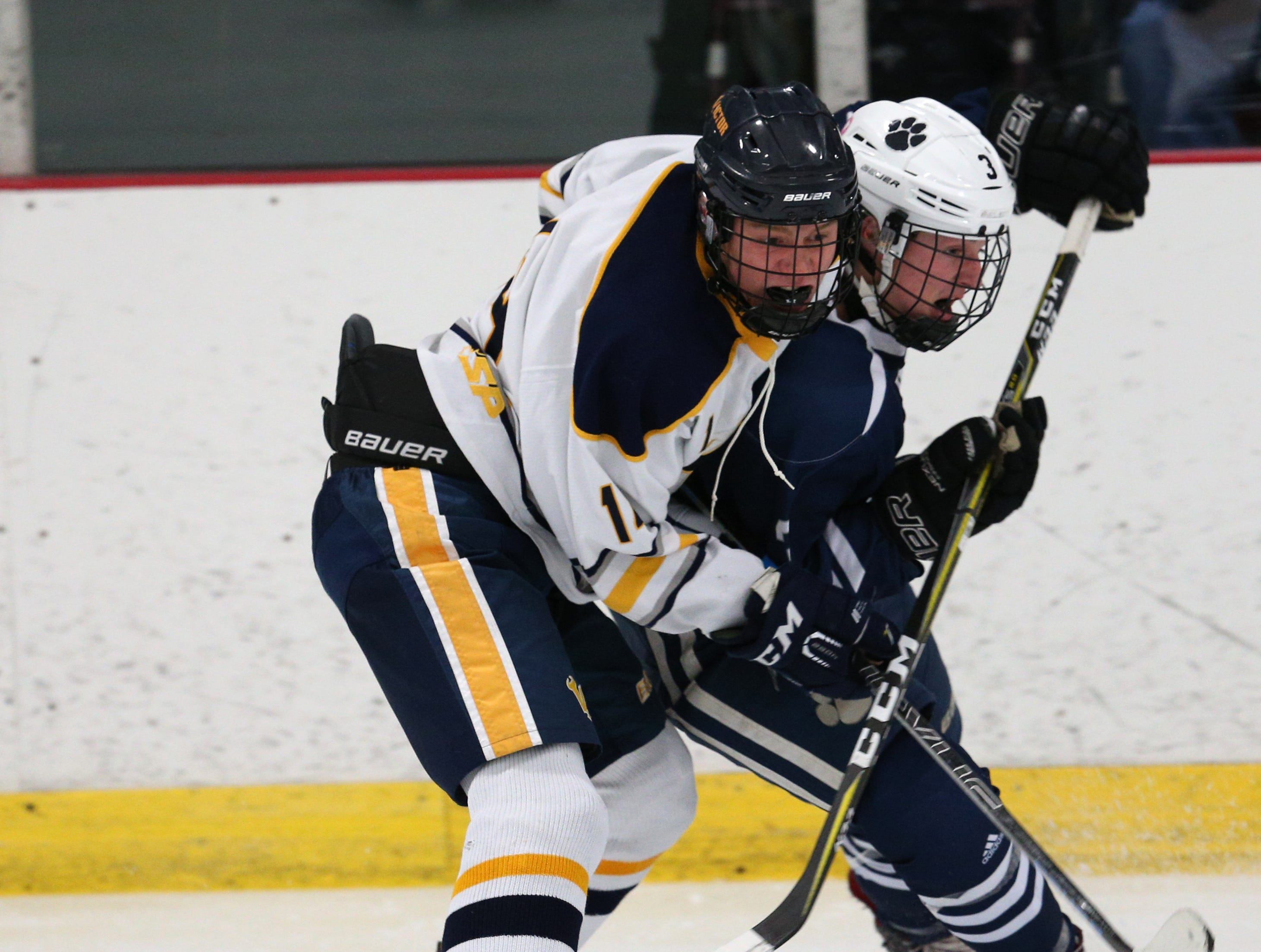 Victor #14 Peter Rydzynski against Pittsford #3 Jack Peterson.