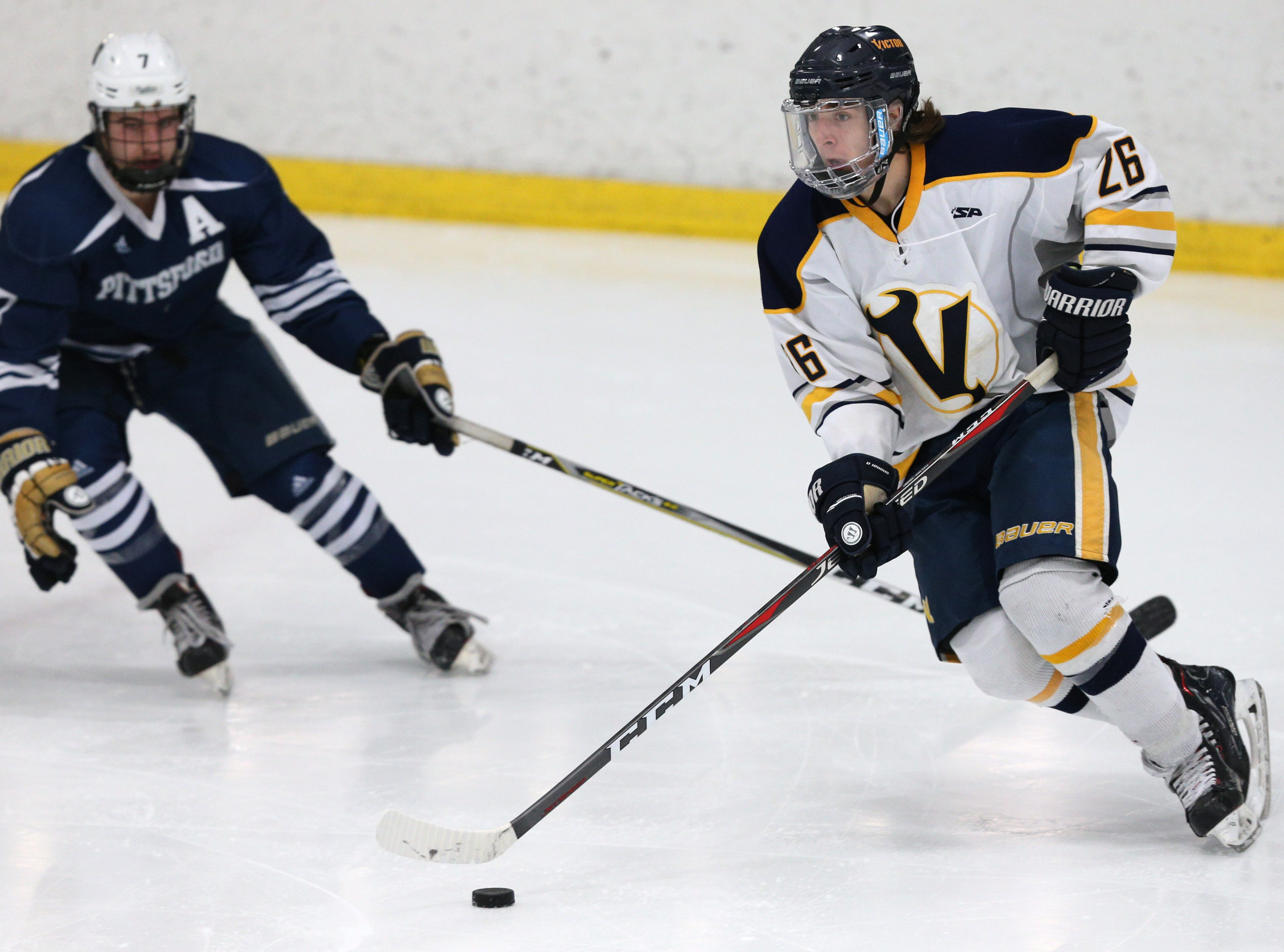 Victor #26 James Tilley against Pittsford.