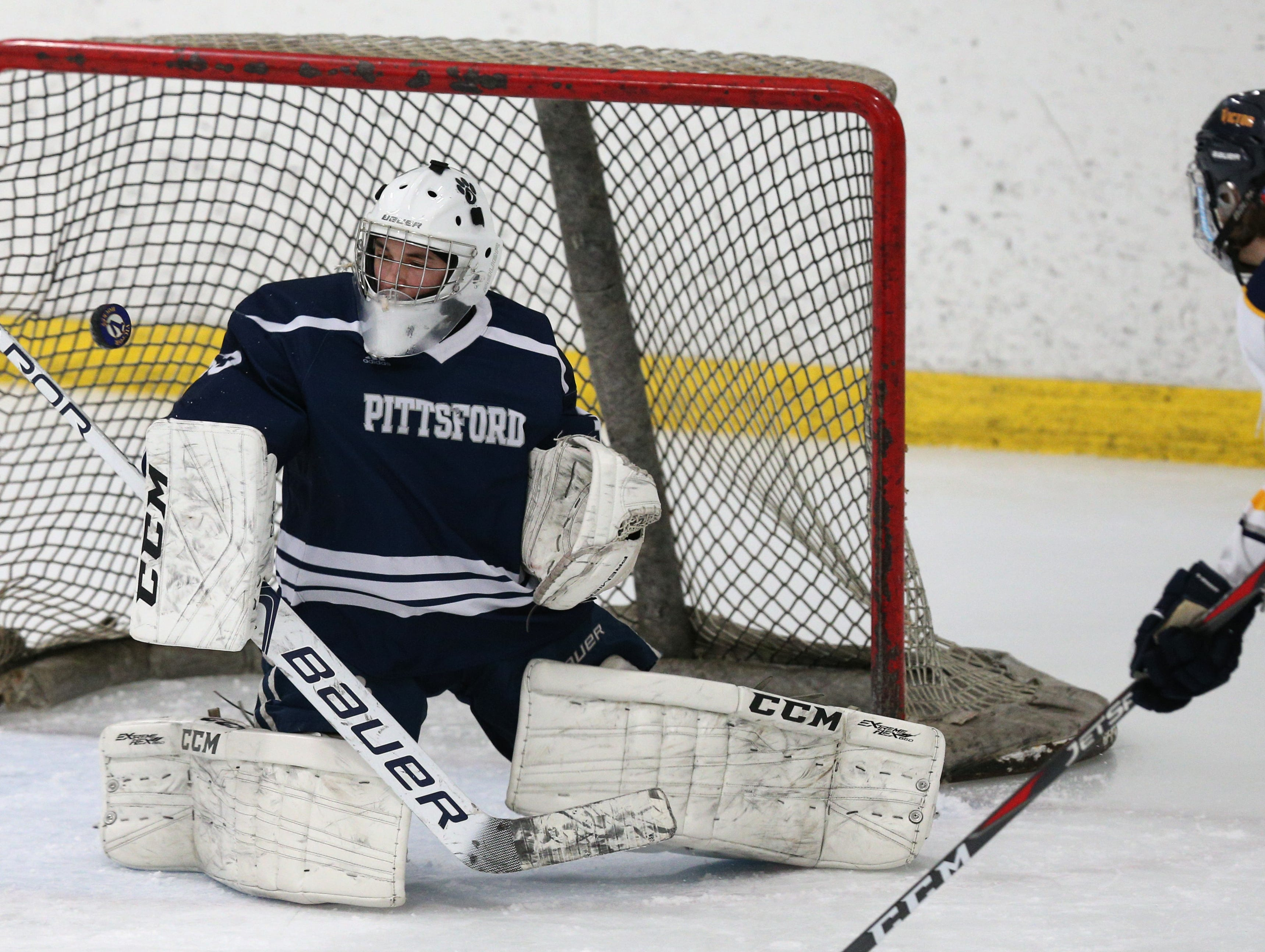 Pittsford #33 Alex Tidd makes a save against Victor.