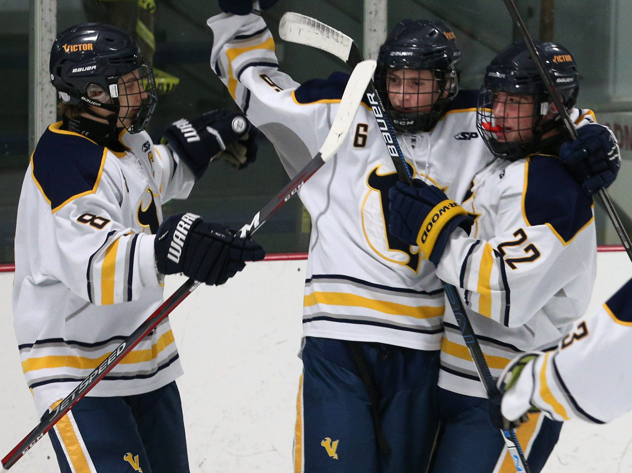 Victor #6 Steven Armstrong celebrates his goal against Pittsford.