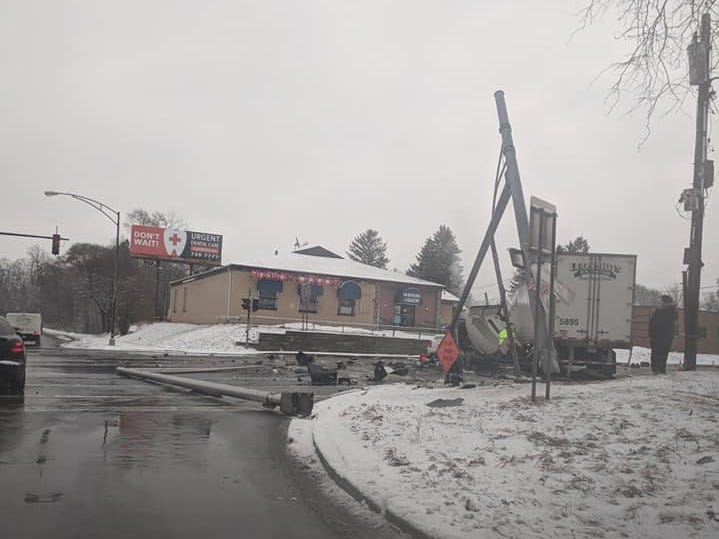 An 18-wheeler can be seen crumpled on Hudson Avenue at State Route 104 in Rochester.