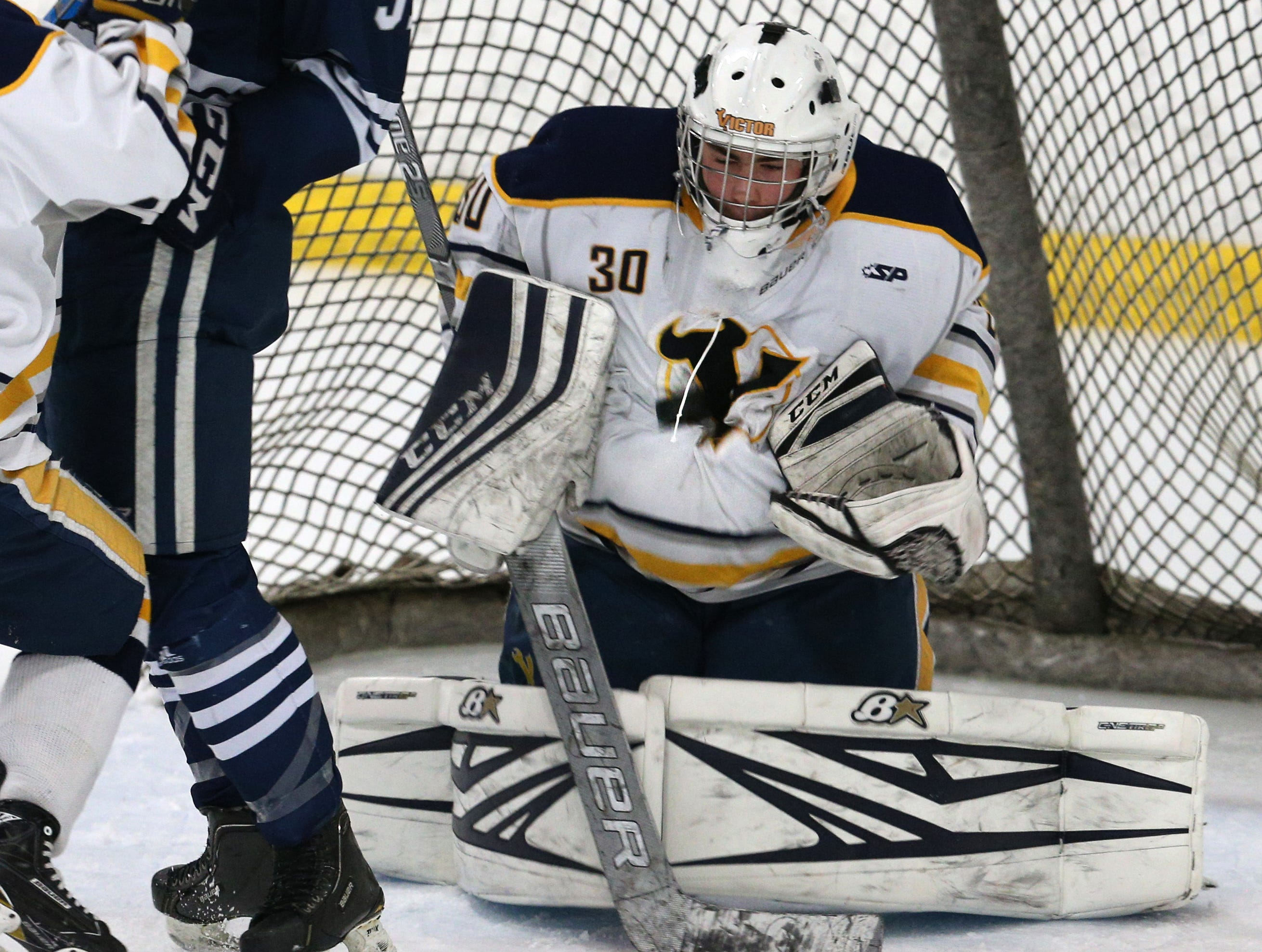 Victor #30 Pieter Bartelse makes this save against Pittsford.