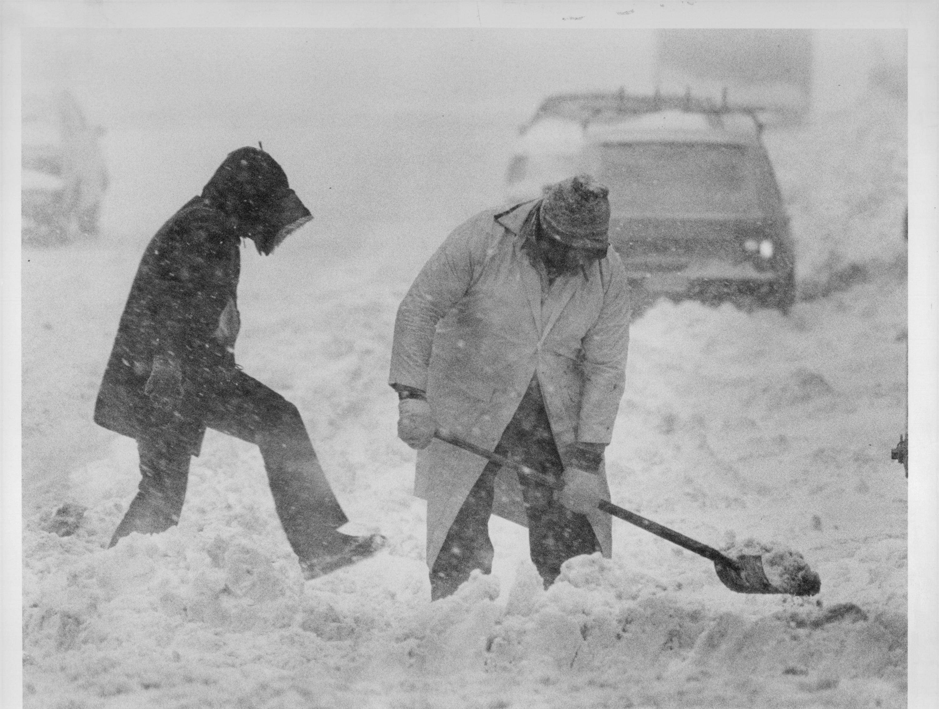 2. Snowfall totaled 32.7 inches from Feb. 27 to March 3, 1984. Here, people dig out a car on a city street.