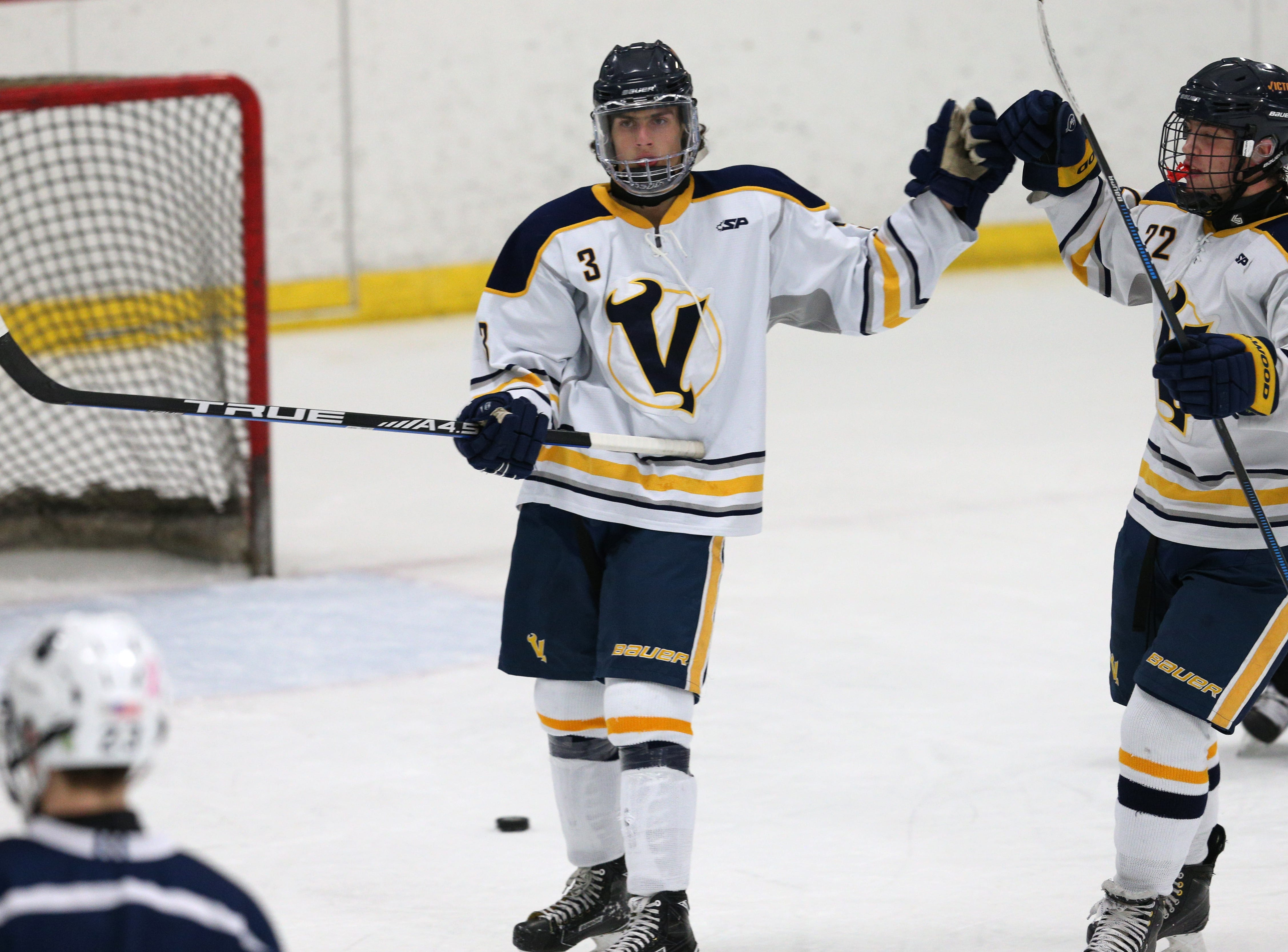 Victor #3 Jack Peterson celebrates his open net goal against Pittsford.