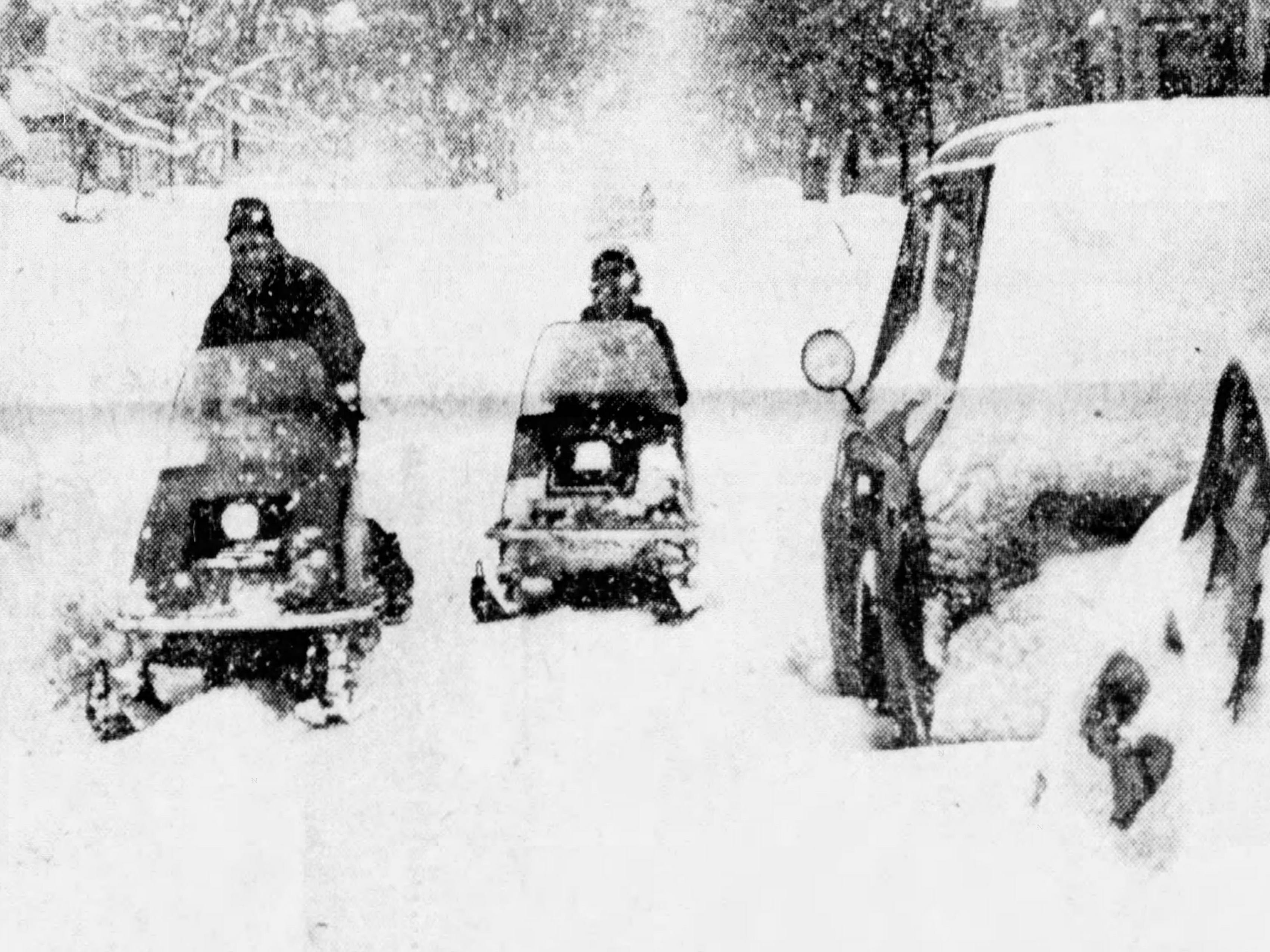 5. Snowfall totaled 25.8 inches between Feb. 5 and Feb. 7, 1978. Here, snowmobilers travel on Meigs Street in Rochester.