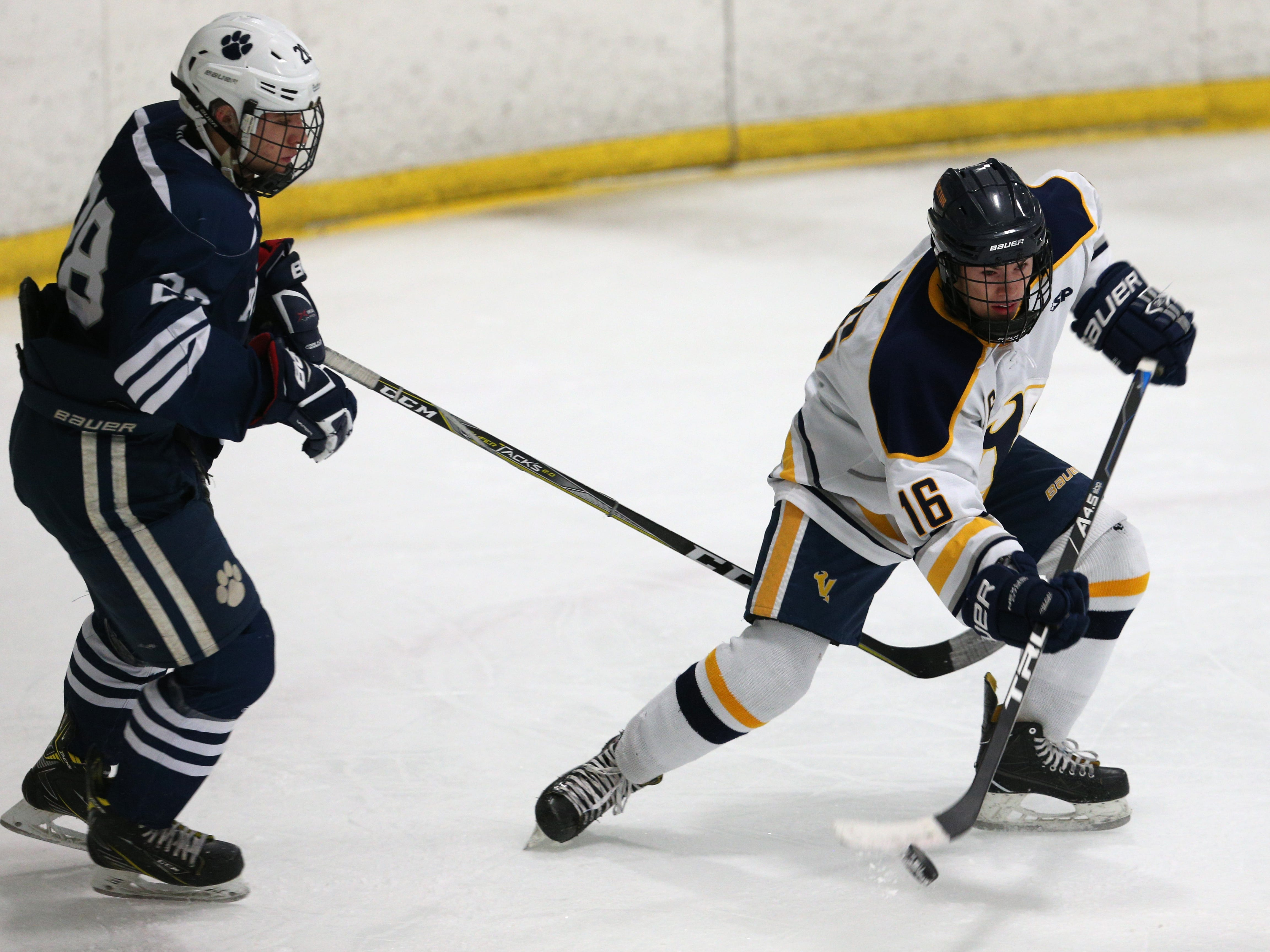 Victor #16 Riley Hauf against Pittsford.