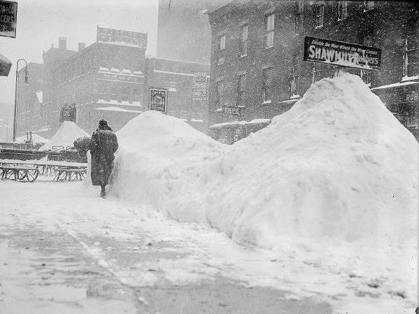 1. Snowfall totaled 29.8 inches on March 1, 1900. Here, a woman walks on North Water Street in Rochester