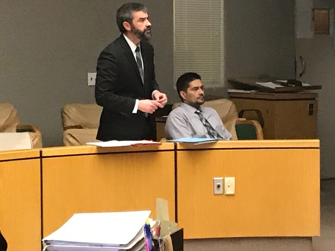 On Friday, Jan. 18, 2019, defense attorney Michael Borges stands next to Juan Manuel Venegas, the man accused of deliberately setting David Wicks on fire and leaving him to die.