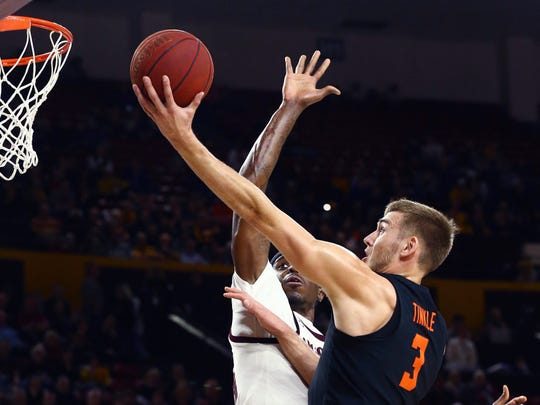 Oregon State forward Tres Tinkle (3) drives past Arizona State forward Zylan Cheatham during the first half of an NCAA college basketball game, Thursday, Jan. 17, 2019, in Tempe, Ariz.