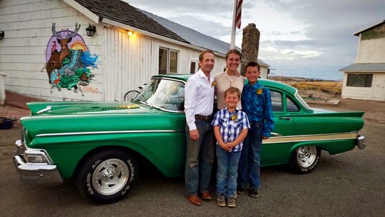 This recent photo provided by Jasmine Tool shows herself with her fiance Daniel Jastrab and their sons Jameson, right, and Silas.