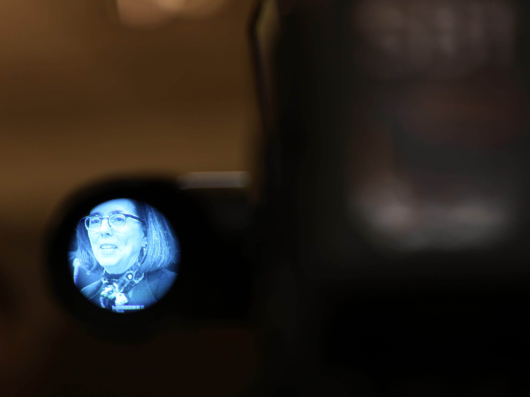 Gov. Kate Brown speaks, as seen through a video camera viewfinder,  during the AP Legislative Preview Day at the Oregon State Capitol in Salem on Friday, Jan. 18, 2019. The 2019 Oregon legislative session begins January 22.