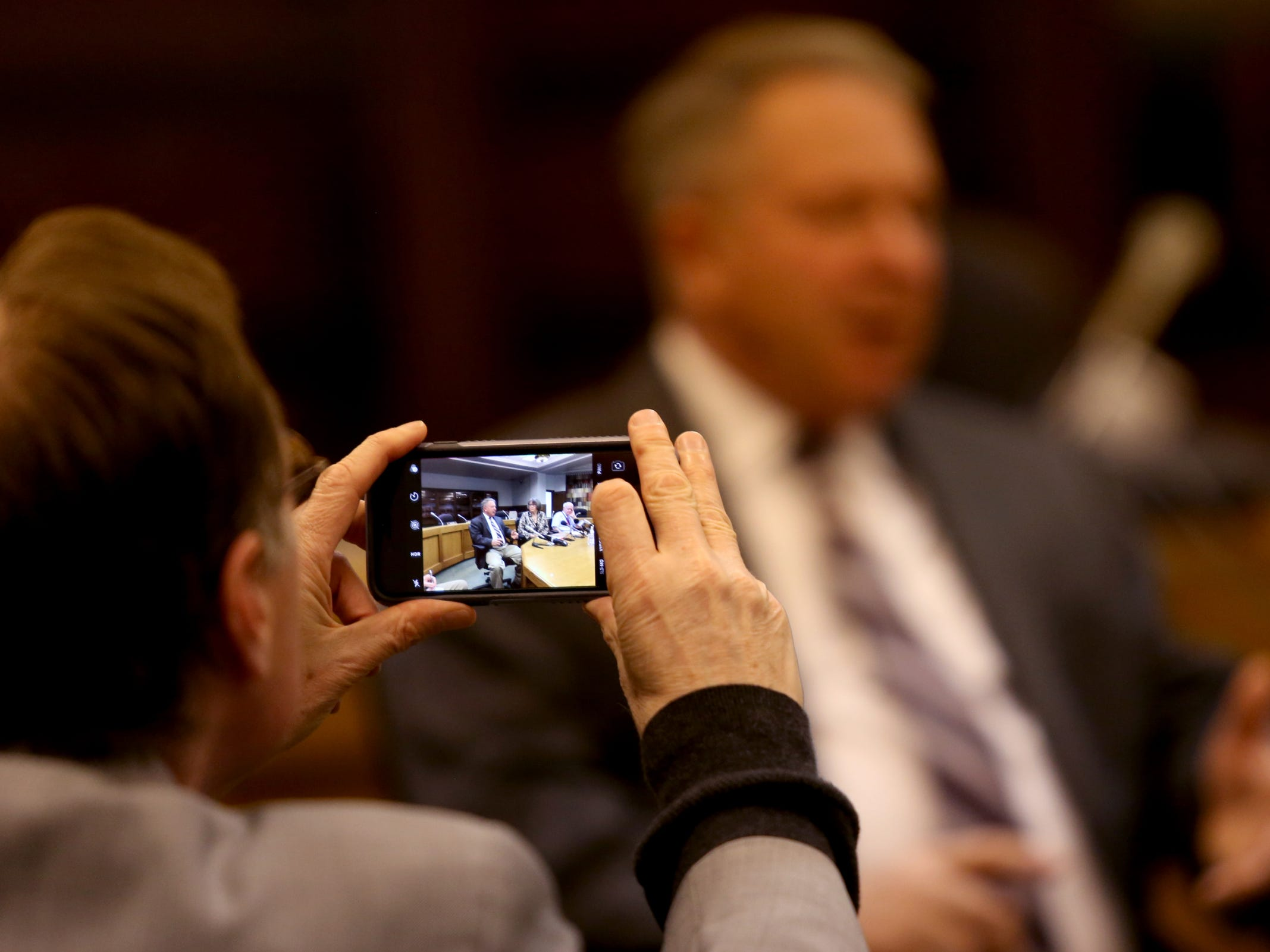 A reporter takes a photo during the AP Legislative Preview Day at the Oregon State Capitol in Salem on Friday, Jan. 18, 2019. The 2019 Oregon legislative session begins January 22.