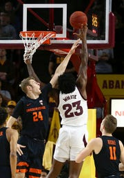 Arizona State forward Romello White (23) shoots over Oregon State forward Kylor Kelley (24) as Oregon State guard Zach Reichle (11) looks on during the first half of an NCAA college basketball game, Thursday, Jan. 17, 2019, in Tempe, Ariz.