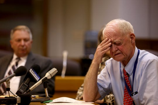 Senate President Peter Courtney rubs his forehead while sitting with Sen. Herman Baertschiger Jr., R-Grants Pass, and Sen. Ginny Burdick, D-Portland, during the AP Legislative Preview Day at the Oregon State Capitol in Salem on Friday, Jan. 18, 2019. The 2019 Oregon legislative session begins January 22.