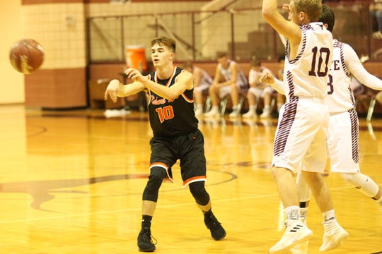 Robert Lee High School's Jayton Warren passes the ball as Bronte's Garrett Knight closes in during a District 11-1A basketball game at the Bronte gym on Thursday, Jan. 17, 2019.