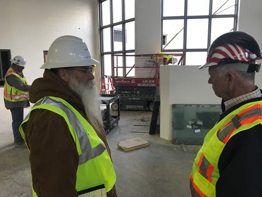 Tom Green County Construction Project Manager Don Killam, left, visits with Precinct 3 Commissioner Rick Bacon at the new jail under construction north of town.