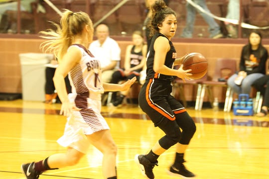 Robert Lee High School's Jullisa Ureno (right) drives toward the basket as Bronte's Jayden Speary defends during a District 11-1A basketball game at the Bronte gym on Thursday, Jan. 17, 2019. Robert Lee won 53-34.