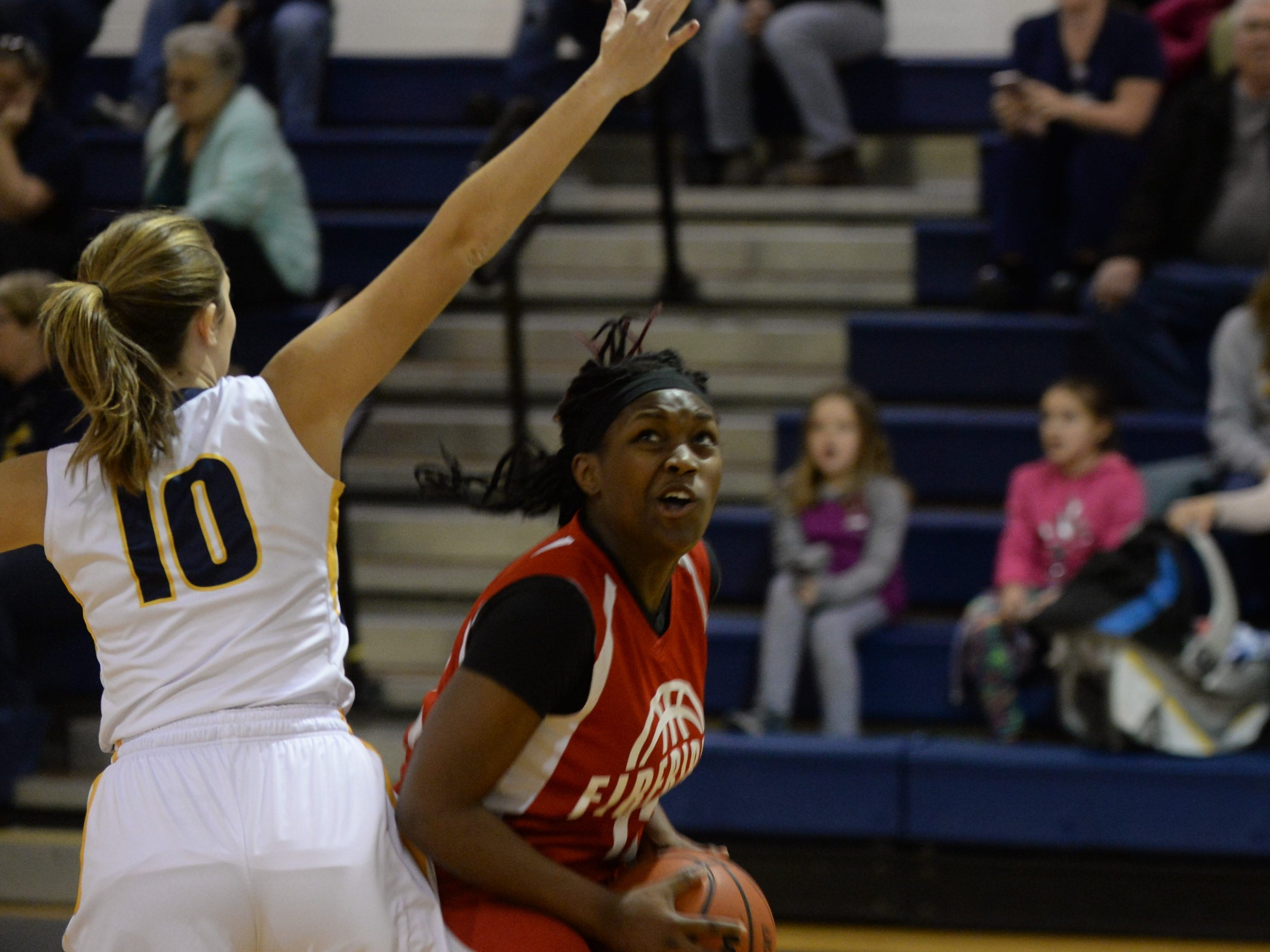 Arcadia's Denija Woolford looks to the net against Chincoteague on Thursday, Jan. 17, 2019.