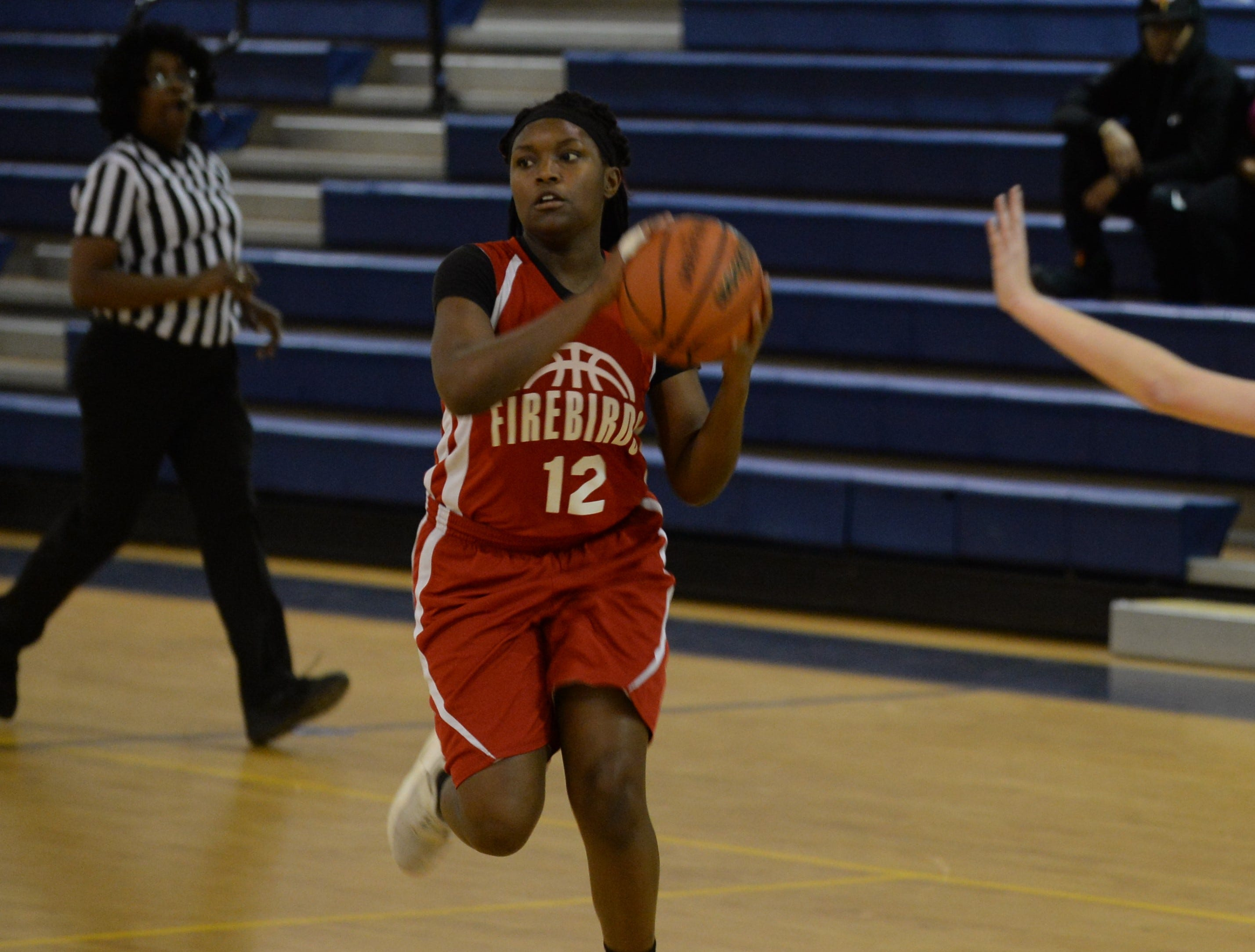 Arcadia's Denija Woolford looks to pass against Chincoteague on Thursday, Jan. 17, 2019.