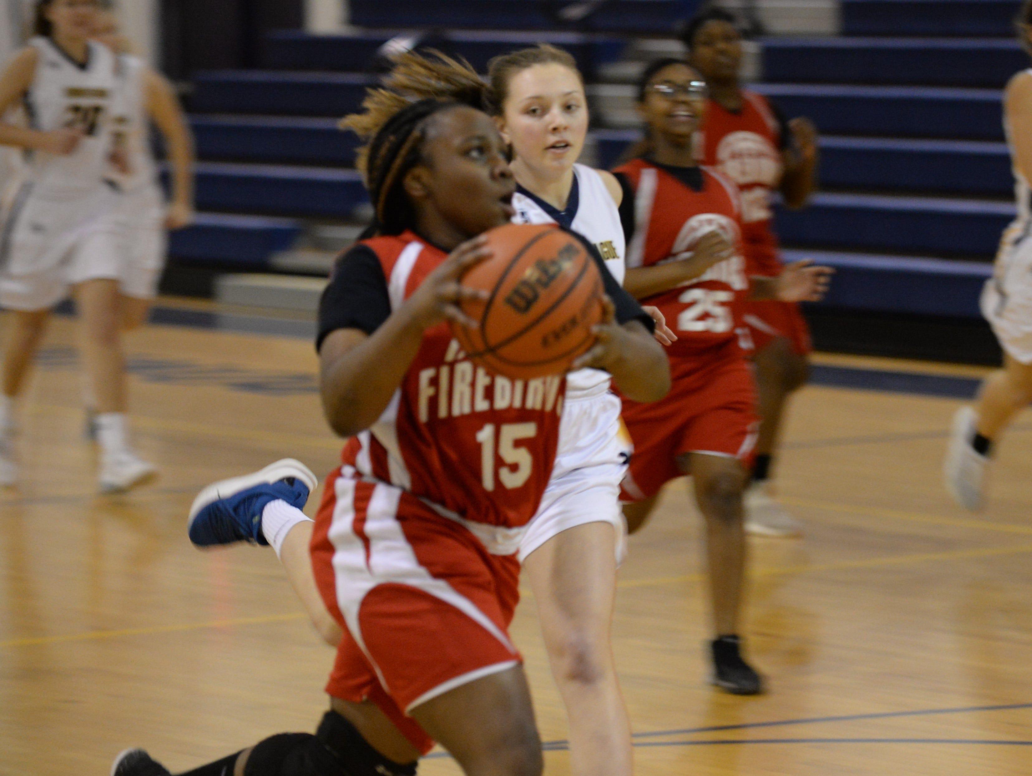 Arcadia's Kaylah Wharton drives to the basketball against Chincoteague on Thursday, Jan. 17, 2019.