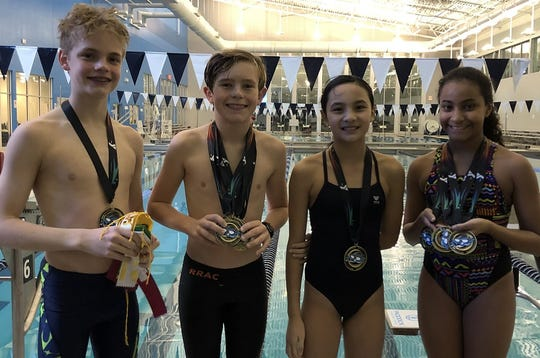 Red River Aquatic Club swimmers Marcus Rhoades, Harrison Jacobs, Jolie Vo and Allie Taylor display their medals won last weekend in the Shreveport YMCA regional.