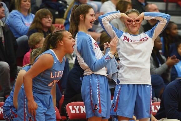 Lincoln's sideline celebrates during the game against Brandon Valley Thursday, Jan. 17, at Brandon Valley.