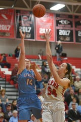 Lincoln's Emma Osmundson and Brandon Valley's Hailey Pieper go for the ball during the game Thursday, Jan. 17, at Brandon Valley.