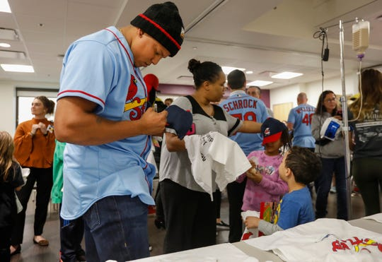 Former Springfield Cardinals utility player Yairo Munoz signs a hat during the Cardinals Caravan visit to Mercy Hospital on Friday, Jan. 18, 2019.