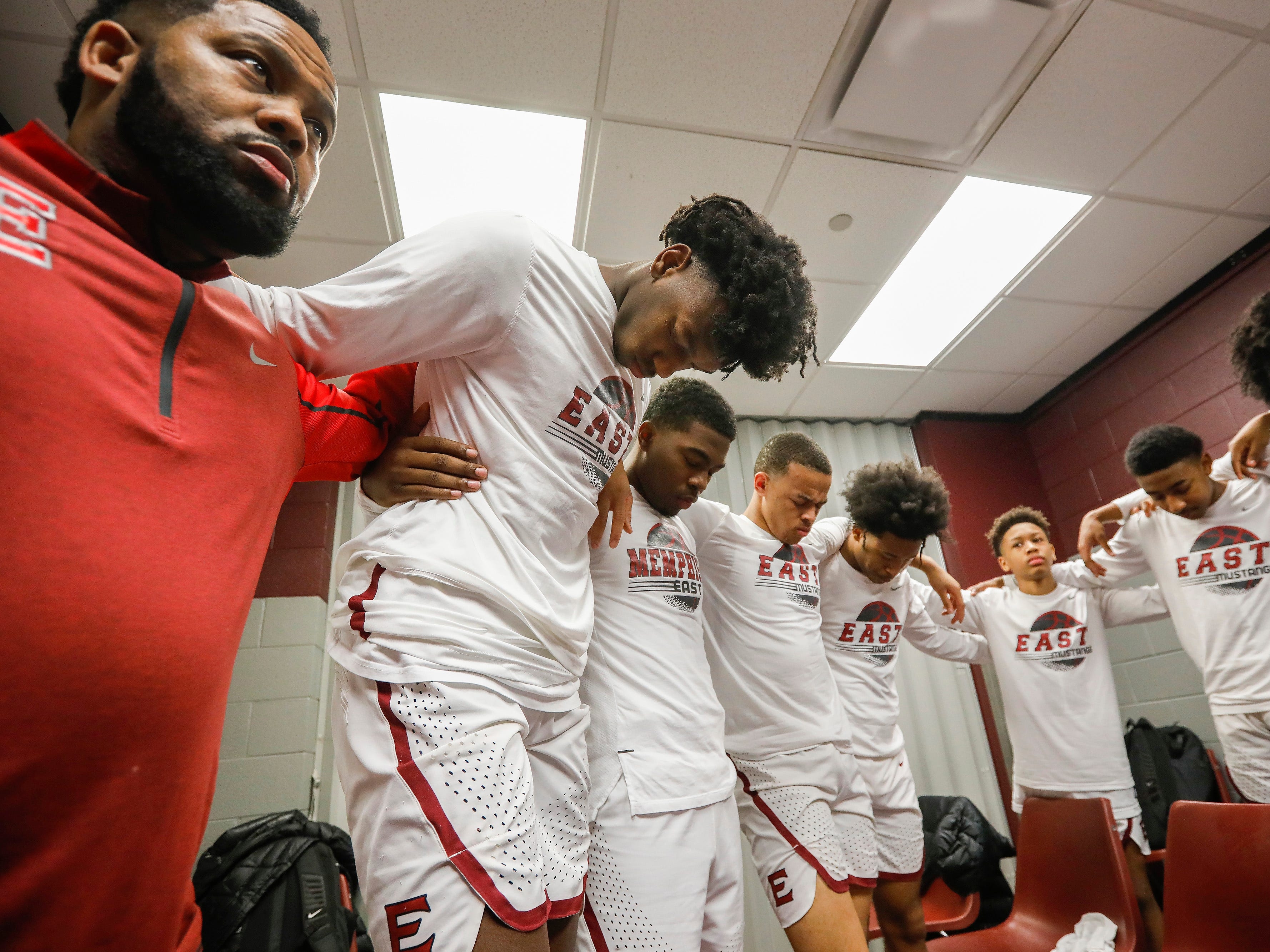 James Wiseman, center left, of Memphis East High School, bows his head for a prayer in the locker room at JQH Arena for the Bass Pro Shops Tournament of Champions on Thursday, Jan. 17, 2019.