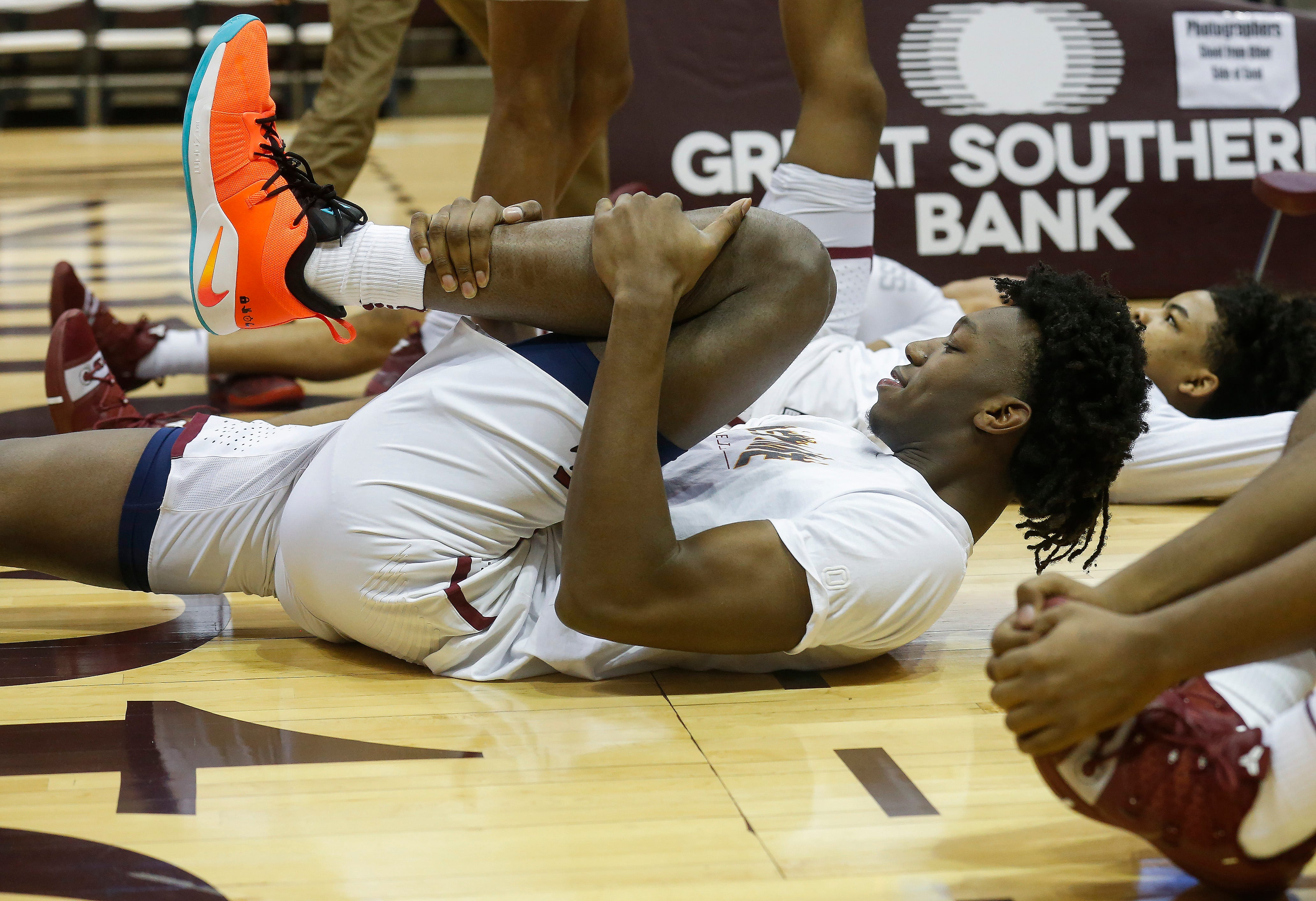 James Wiseman, of Memphis East High School, stretches before his team's game in the Bass Pro Shops Tournament of Champions at JQH Arena on Thursday, Jan. 17, 2019.