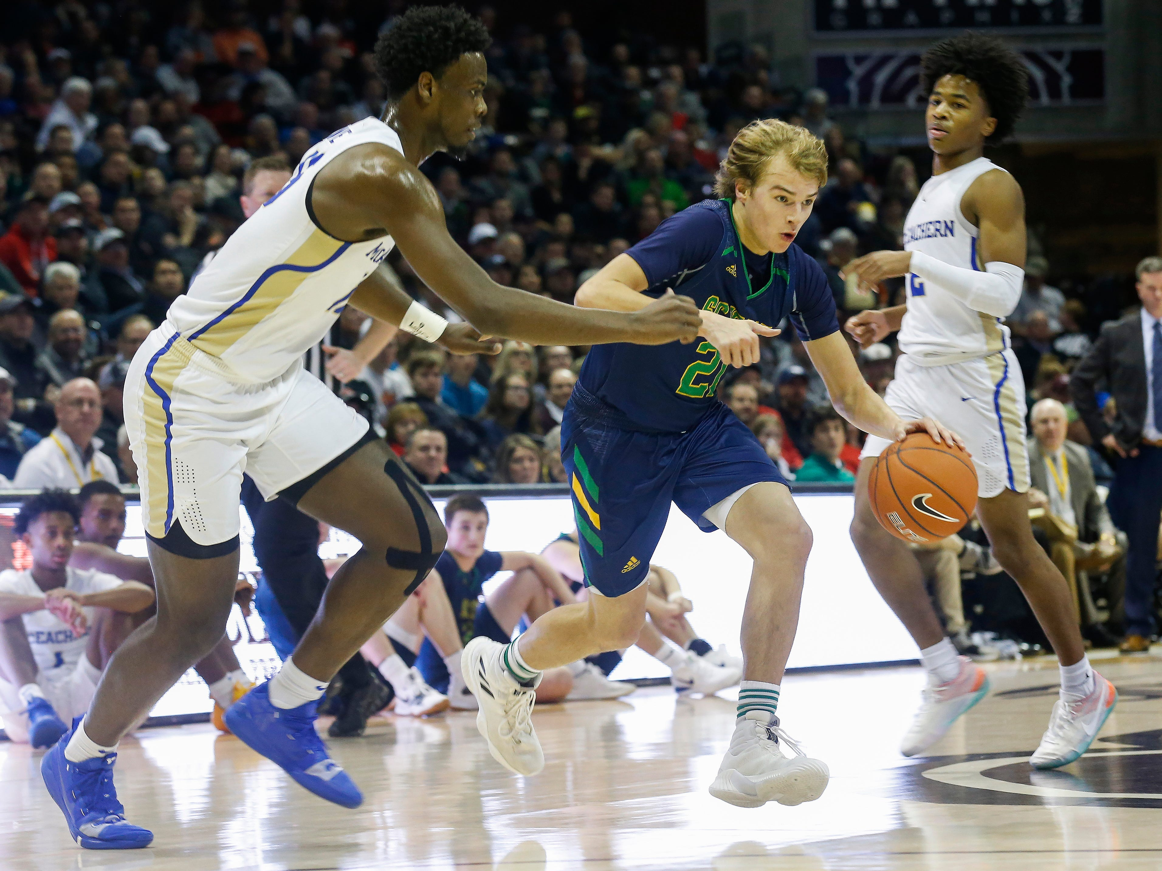 Charlie O'Reilly, of Springfield Catholic, brings the ball down the court the Irish's  game against McEachern at the Bass Pro Shops Tournament of Champions at JQH Arena on Thursday, Jan. 17, 2019.