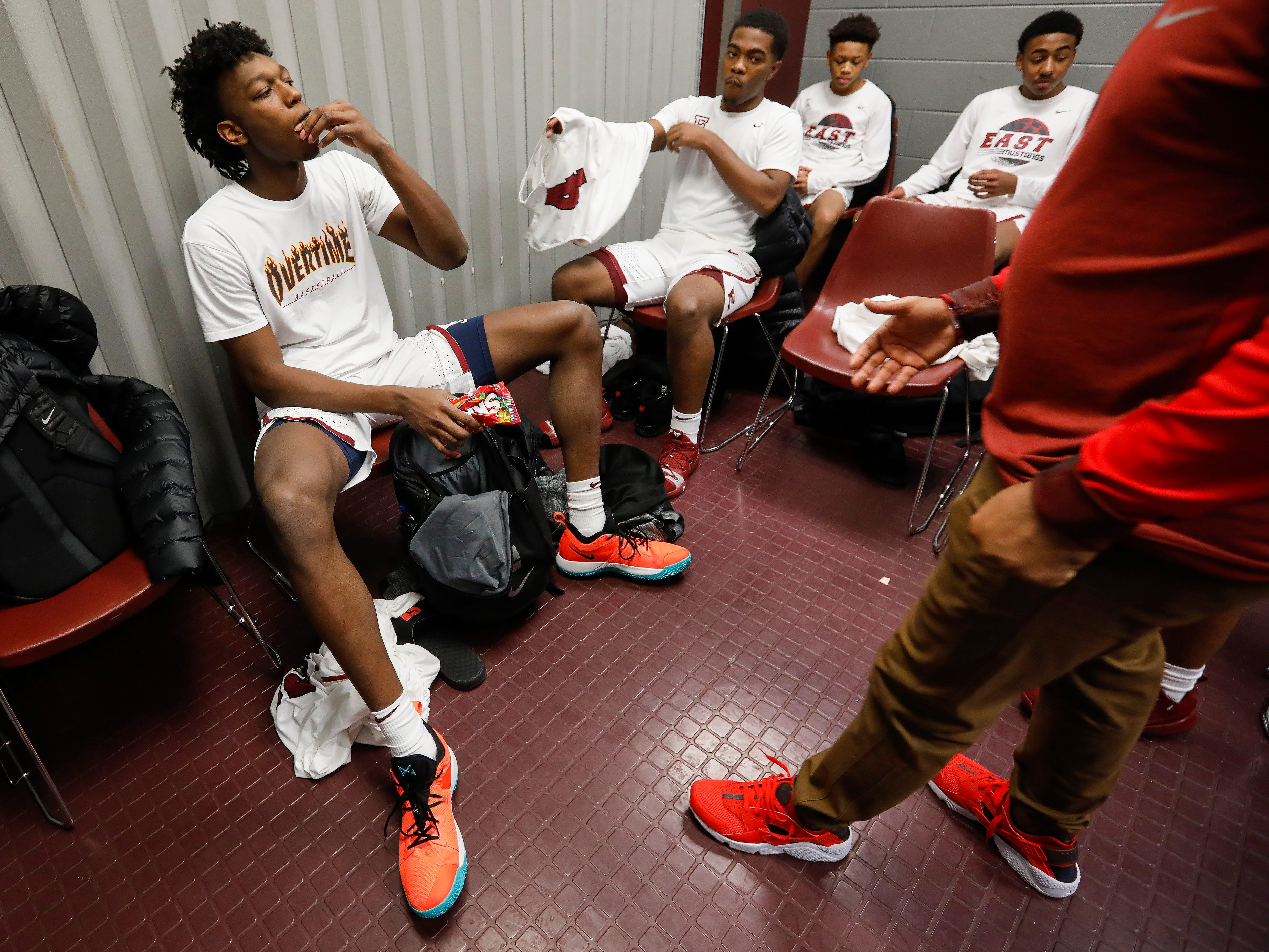 James Wiseman, left, of Memphis East High School, eats a hand full of Skittles in the locker room at JQH Arena for the Bass Pro Shops Tournament of Champions on Thursday, Jan. 17, 2019.