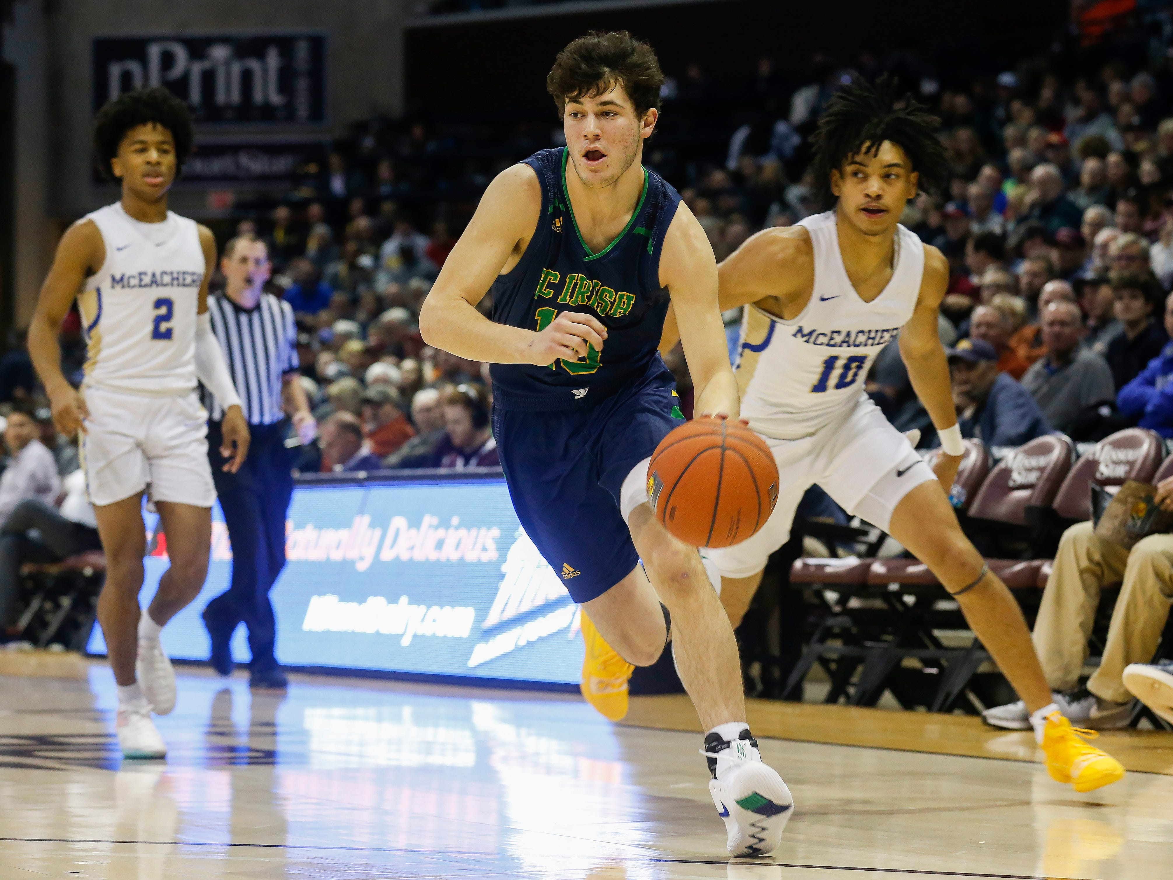 Mike Manzardo, of Springfield Catholic, brings the ball down the court during the Irish's  game against McEachern at the Bass Pro Shops Tournament of Champions at JQH Arena on Thursday, Jan. 17, 2019.