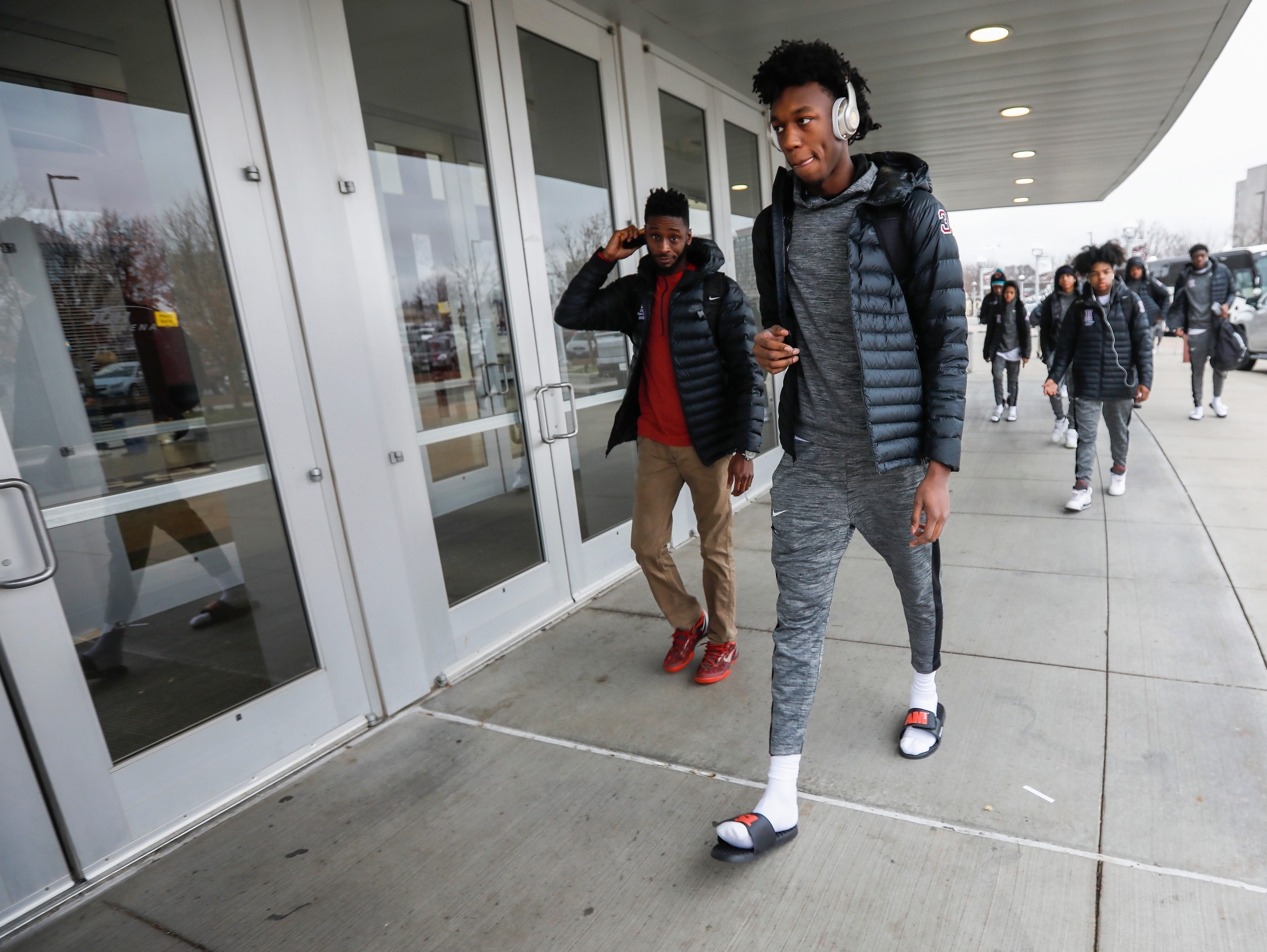 James Wiseman, center left, of Memphis East High School, walks into JQH Arena for the Bass Pro Shops Tournament of Champions on Thursday, Jan. 17, 2019.
