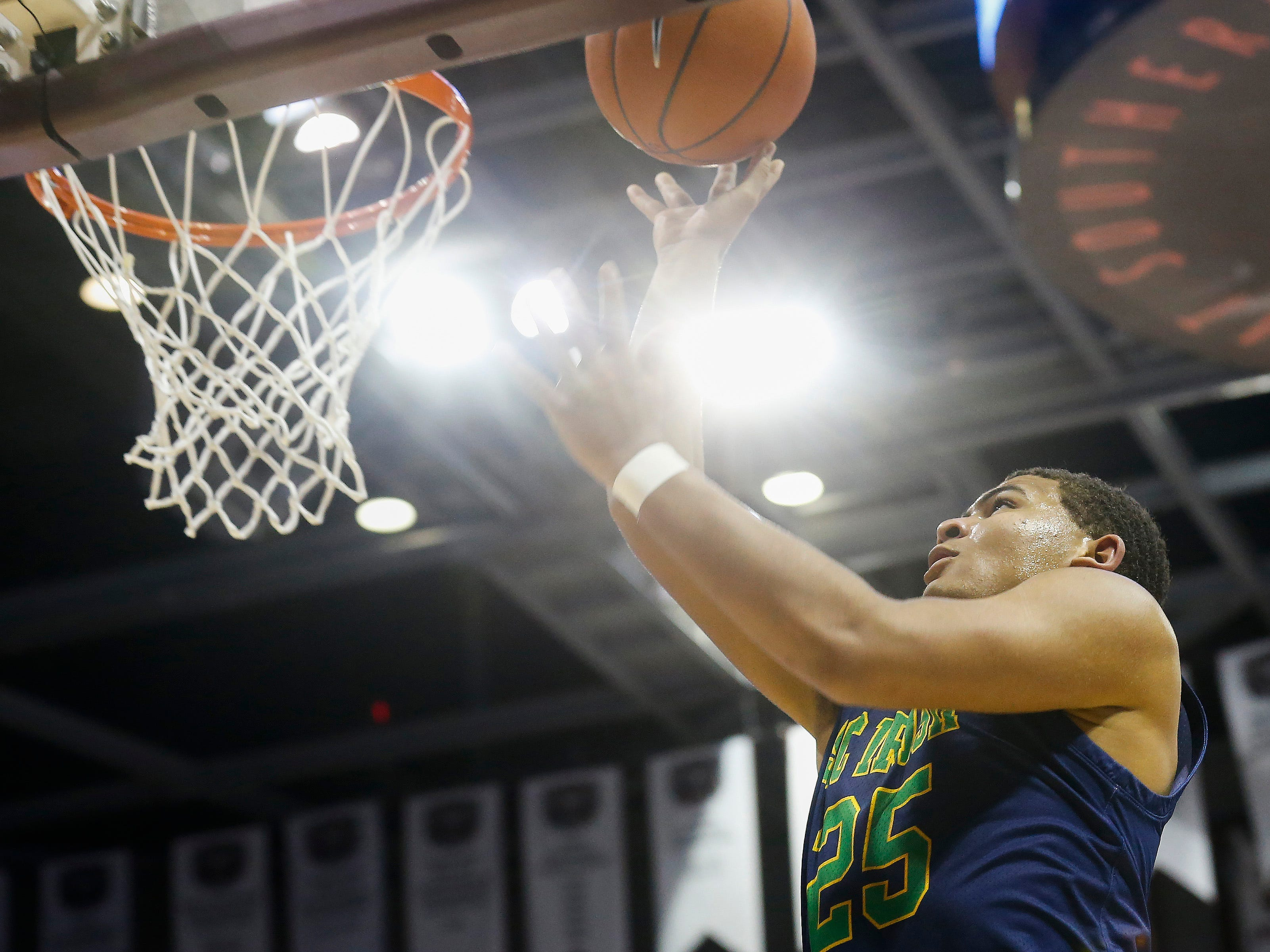 Tyson Riley, of Springfield Catholic, shoots the ball during the Irish's  game against McEachern at the Bass Pro Shops Tournament of Champions at JQH Arena on Thursday, Jan. 17, 2019.