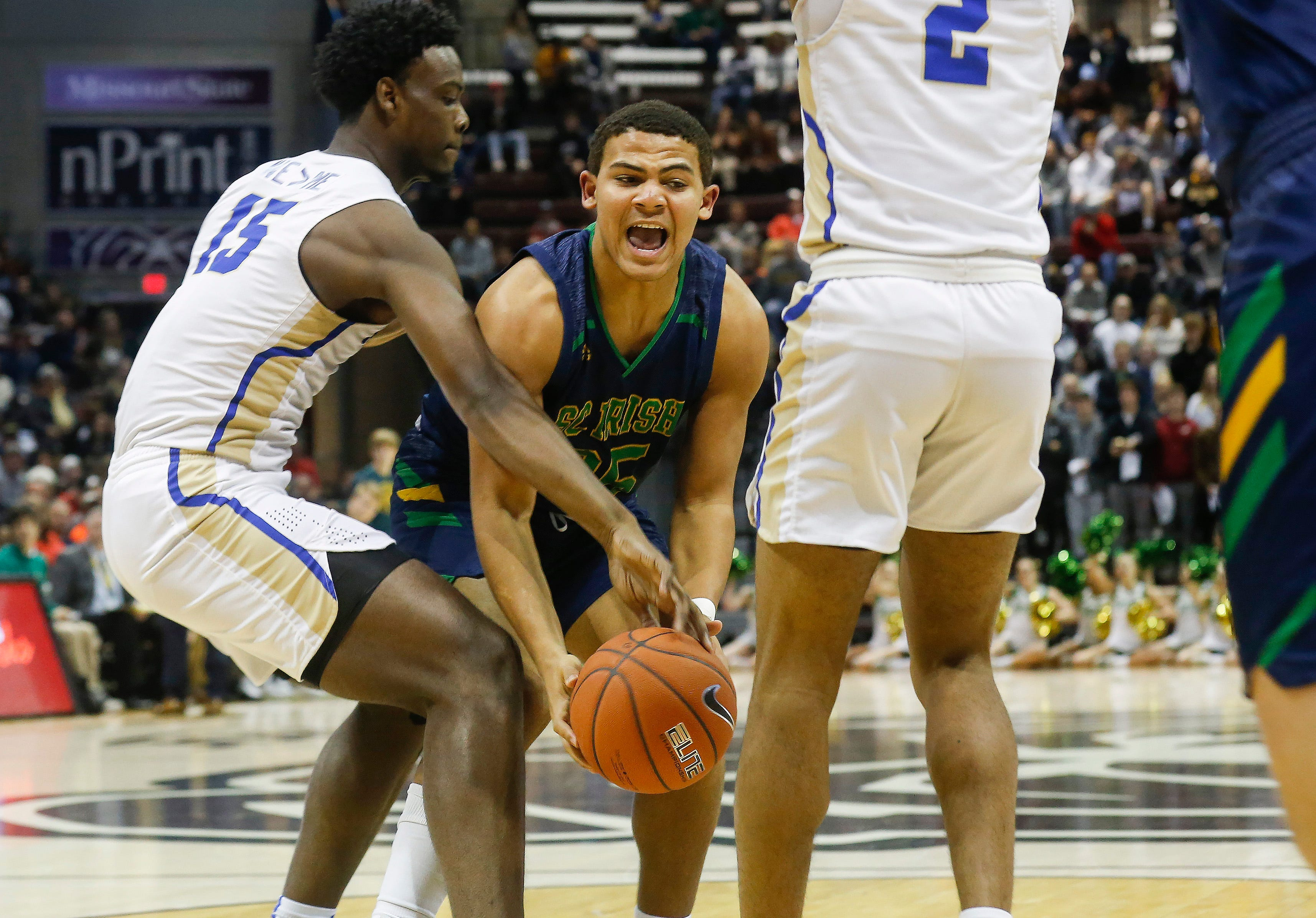 Tyson Riley, of Springfield Catholic, fights for the ball during the Irish's  game against McEachern at the Bass Pro Shops Tournament of Champions at JQH Arena on Thursday, Jan. 17, 2019.