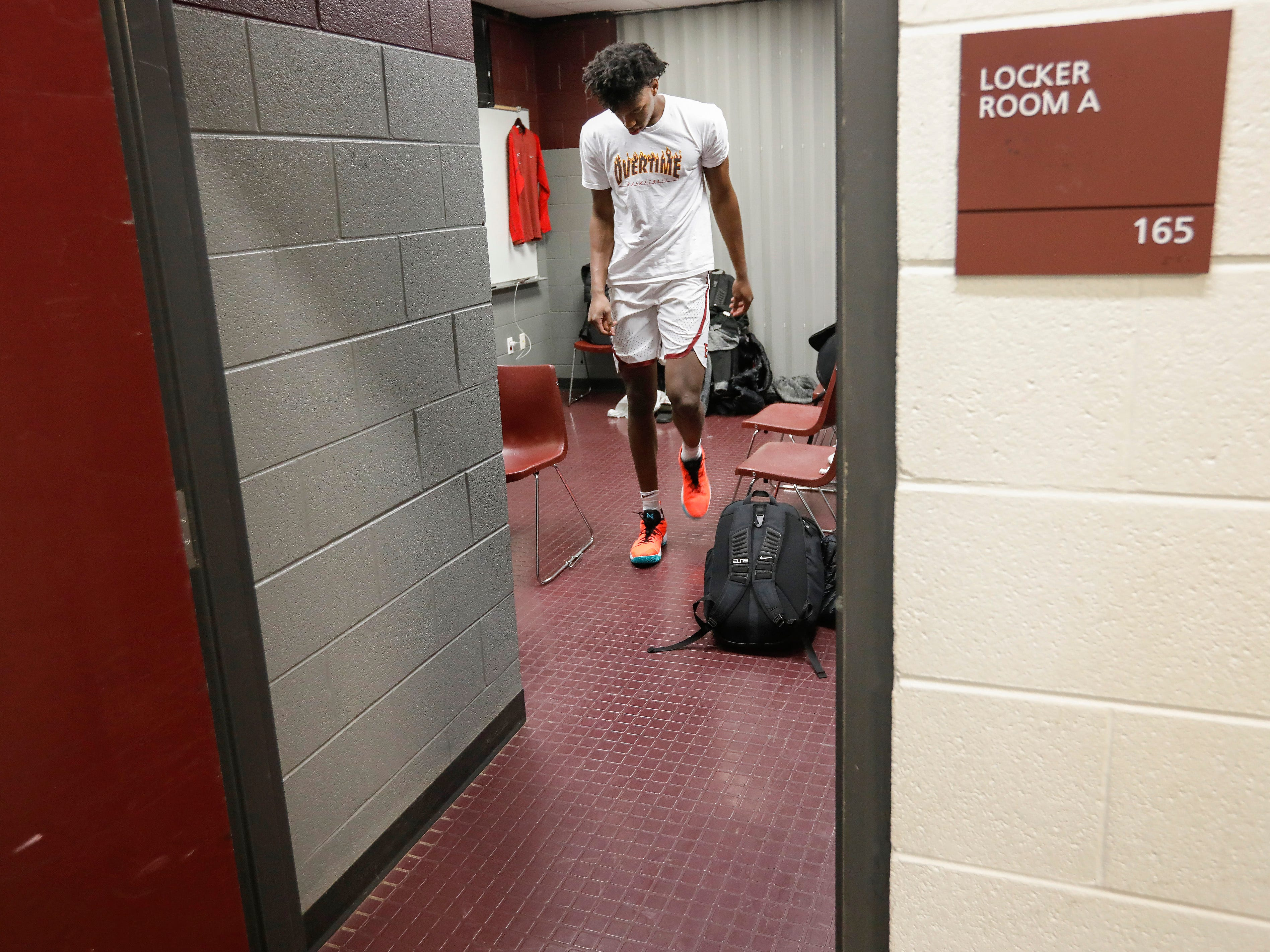 James Wiseman, center, of Memphis East High School, walks out of the locker room at JQH Arena for the Bass Pro Shops Tournament of Champions on Thursday, Jan. 17, 2019.