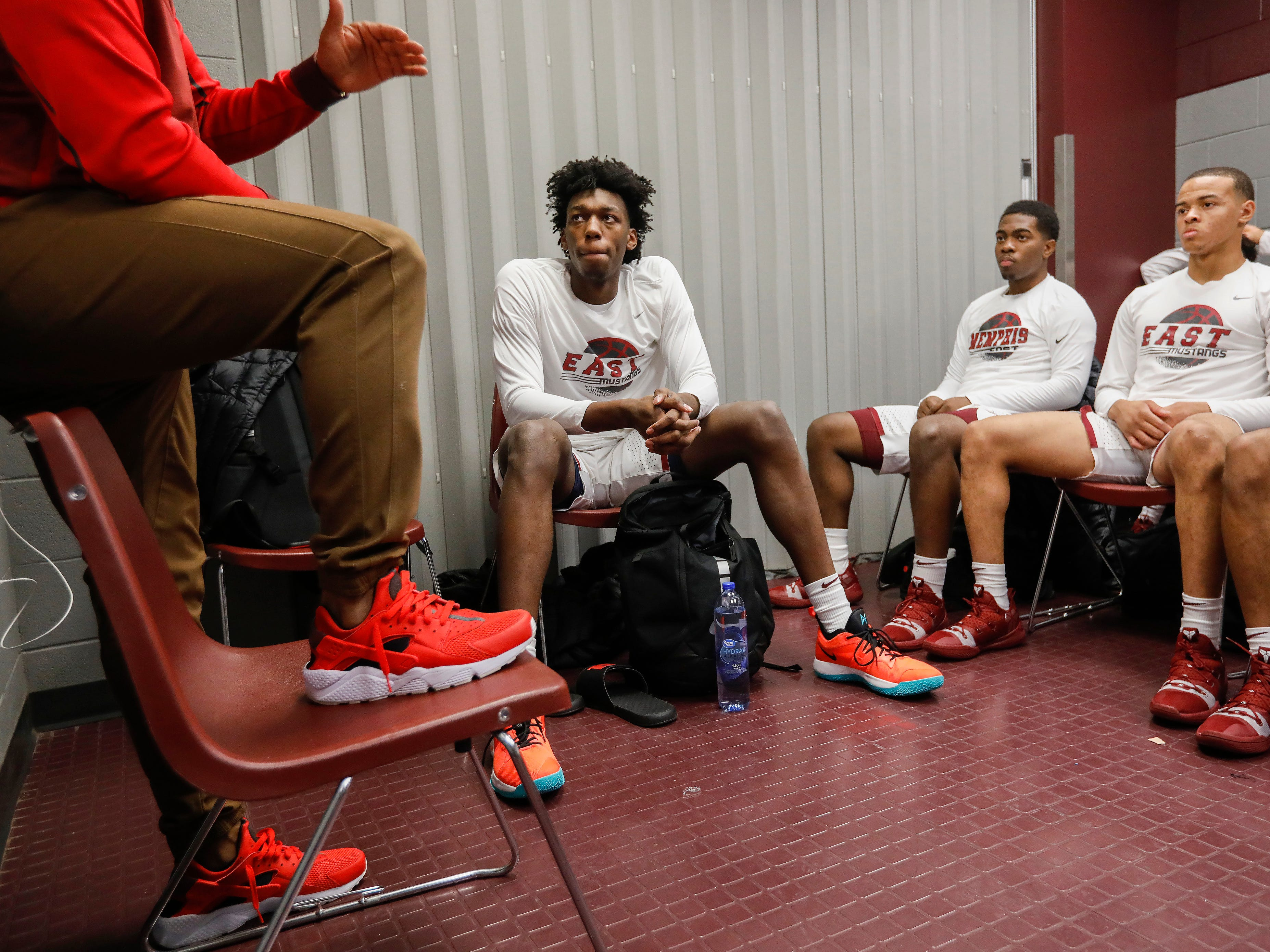 James Wiseman, center, of Memphis East High School, listens to his coach in the locker room at JQH Arena for the Bass Pro Shops Tournament of Champions on Thursday, Jan. 17, 2019.