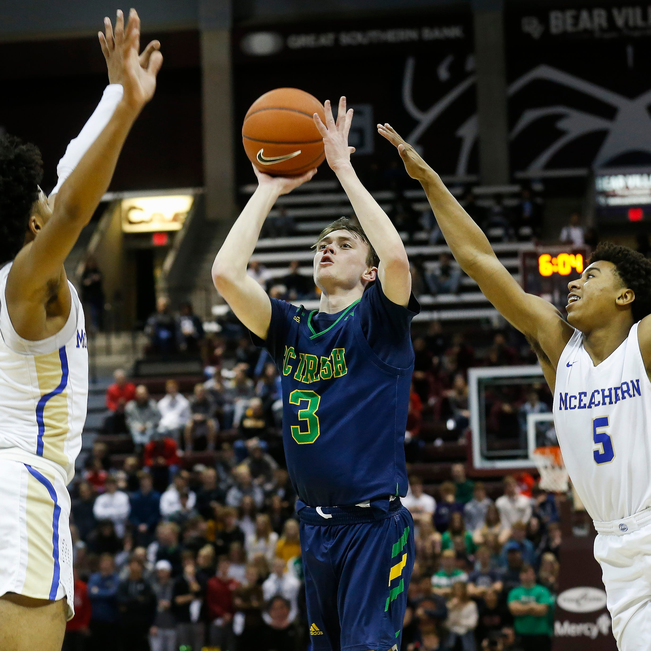 High school hoops roundup: Catholic, Greenwood advance to next round