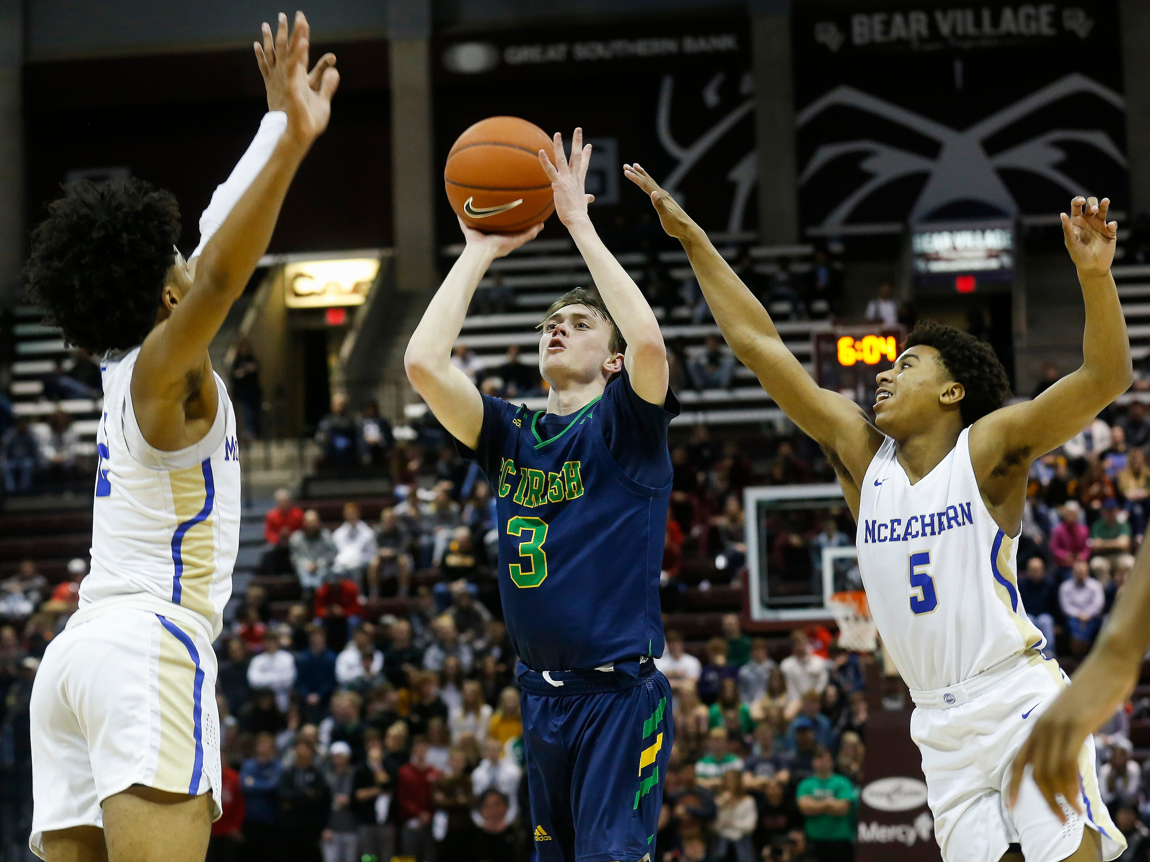Jake Branham, of Springfield Catholic, shoots the ball during the Irish's  game against McEachern at the Bass Pro Shops Tournament of Champions at JQH Arena on Thursday, Jan. 17, 2019.